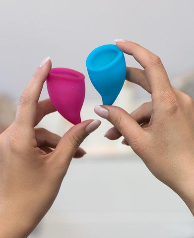 Fun Factory Fun Cup Size A Silicone Menstrual Cups held in a woman's hands