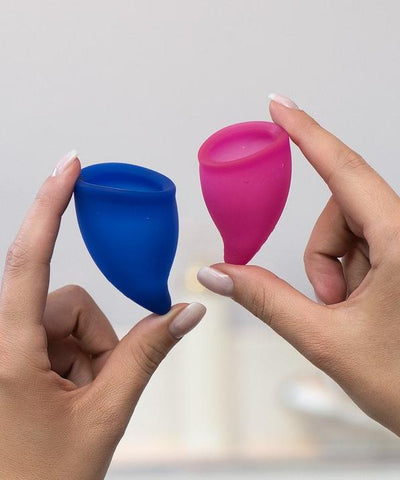 Fun Factory Fun Cup Explore Kit Silicone Menstrual Cups HELD IN A WOMAN'S HANDS