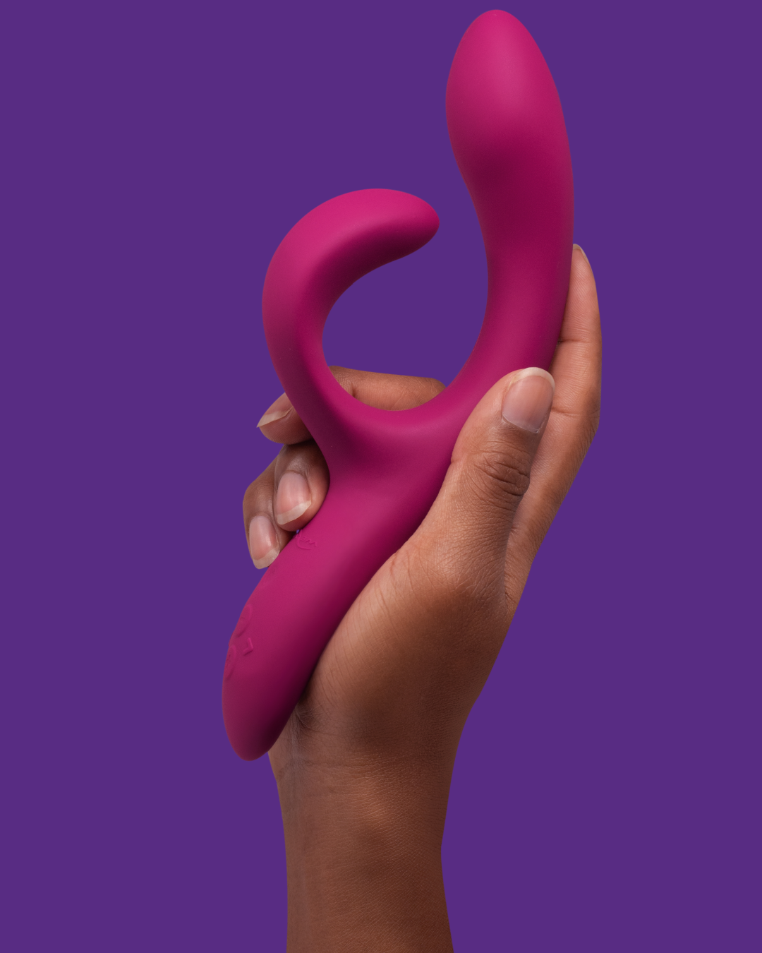 We-Vibe Nova 2 Rechargeable Dual Stimulator Vibrator on purple background in model's hand