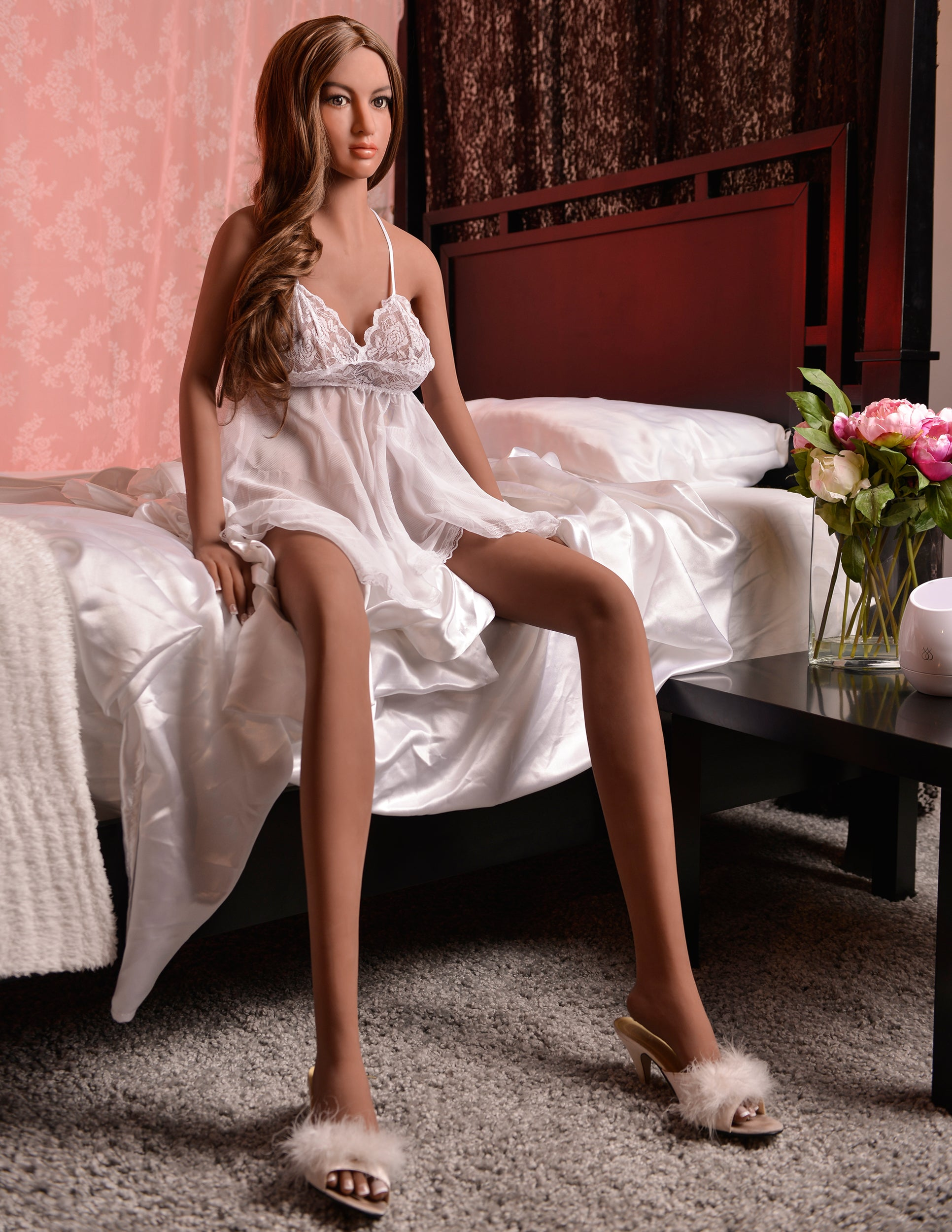 Ultimate Fantasy Dolls - Carmen sitting on the side of a bed wearing a white negligee