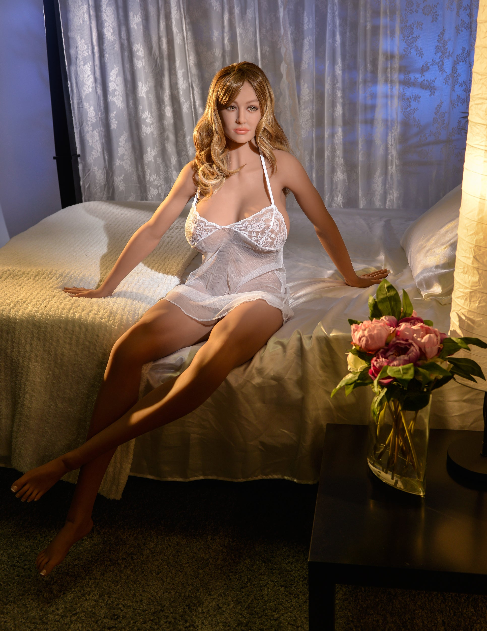 Ultimate Fantasy Dolls - Bianca sitting on a bed wearing a white negligee