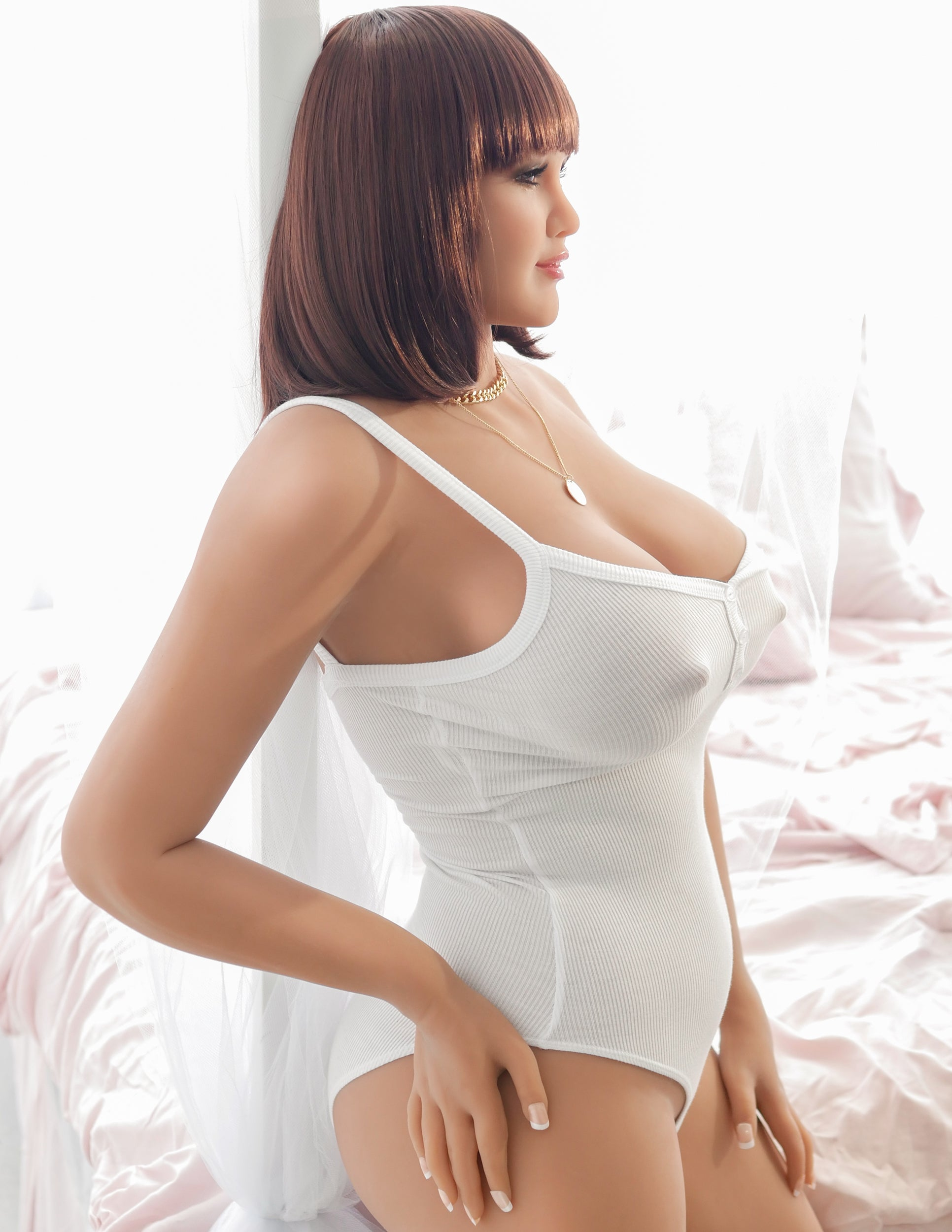 Ultimate Fantasy Dolls - Mia in profile wearing a white body suit