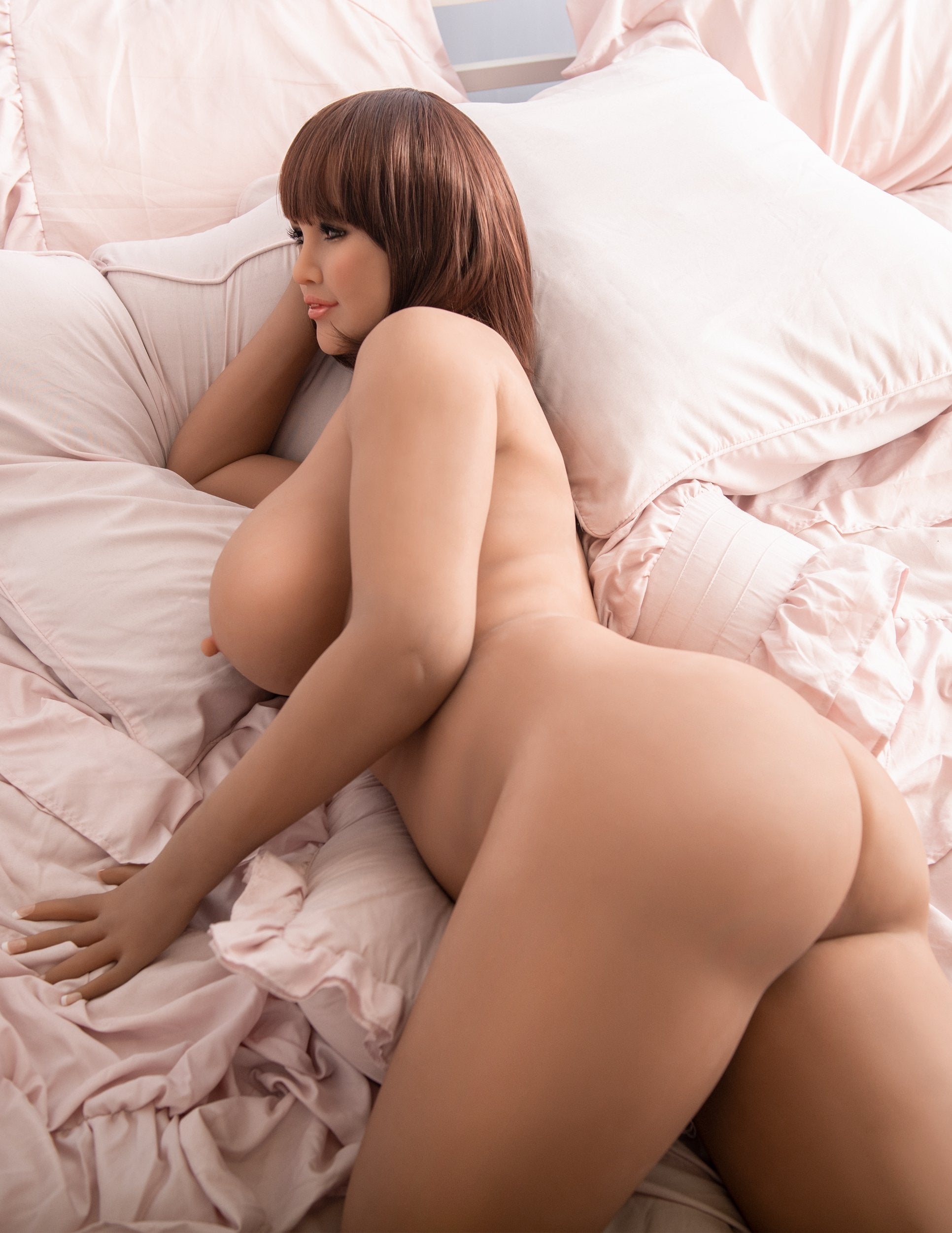 Ultimate Fantasy Dolls - Mia laying naked on a bed