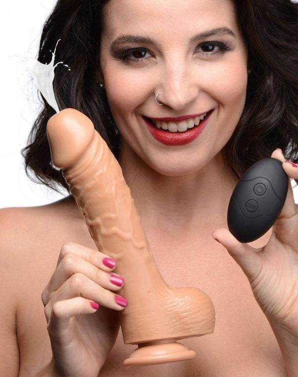 Woman holding a Loadz 7 Inch Vibrating Squirting Dildo with Wireless Remote Control - Caramel