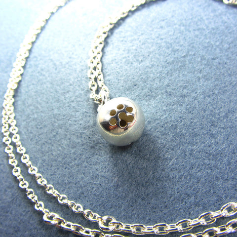 Necklace with paw print bell