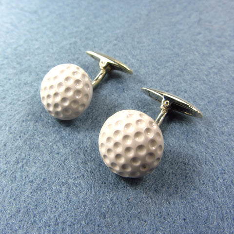 Cuff links golf ball in ceramic cover