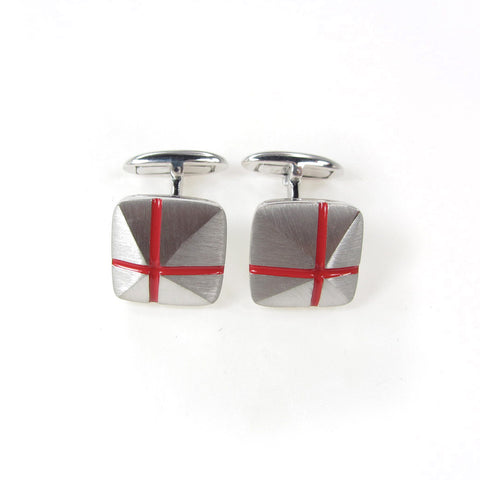 Cuff links with red cross