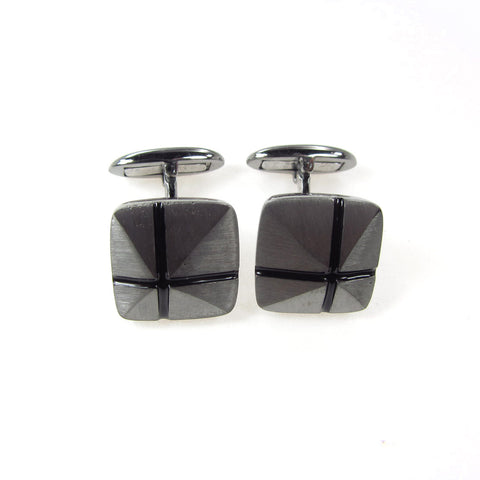 Cuff links with black cross