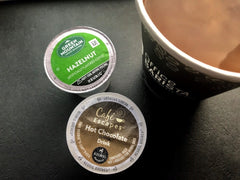 Keurig K Cups With a small paper cup. Coffee Pods with a disposable cup