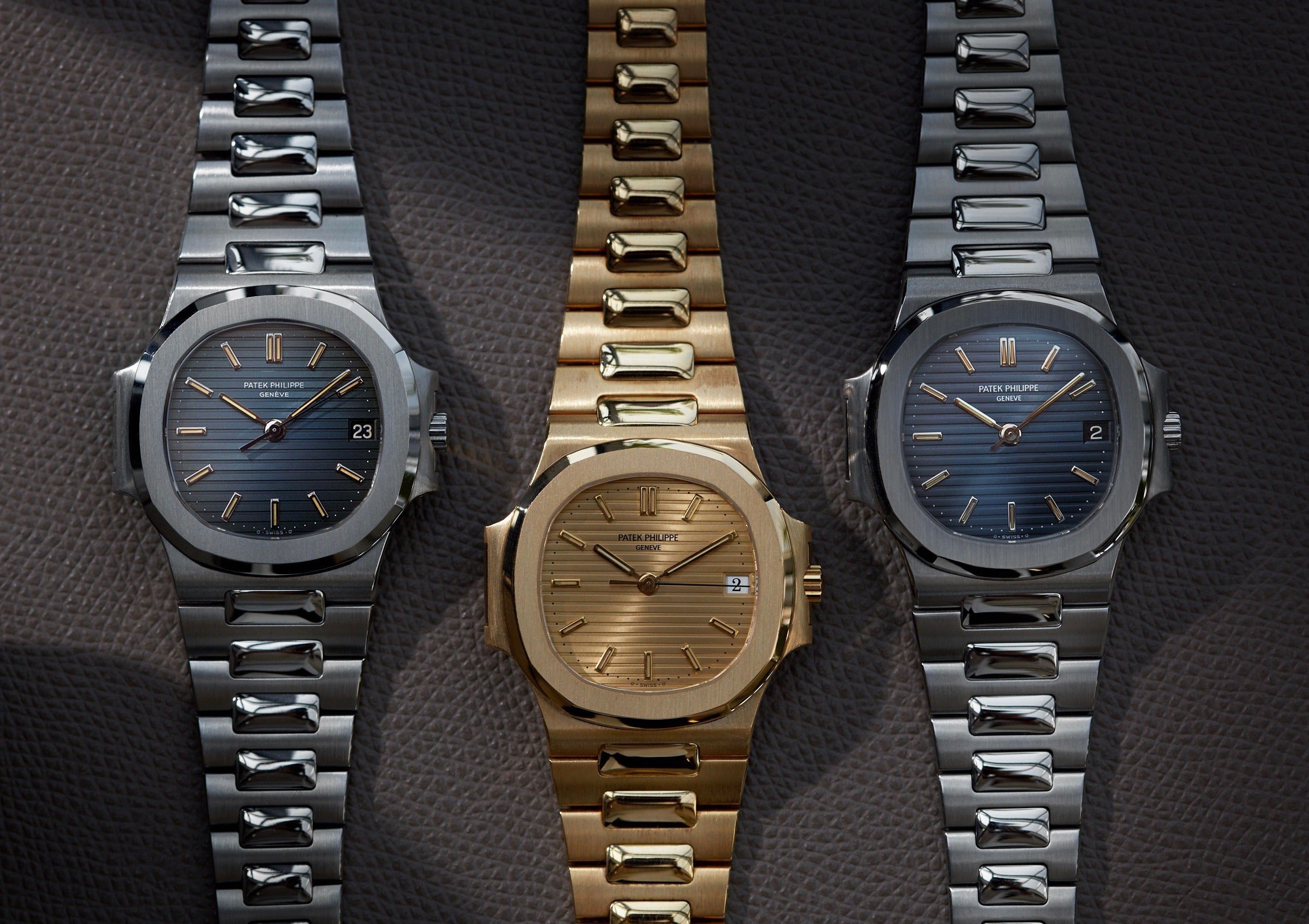 Three Patek Philippe Nautilus 3800s in stainless steel and yellow gold from A Collected Man London