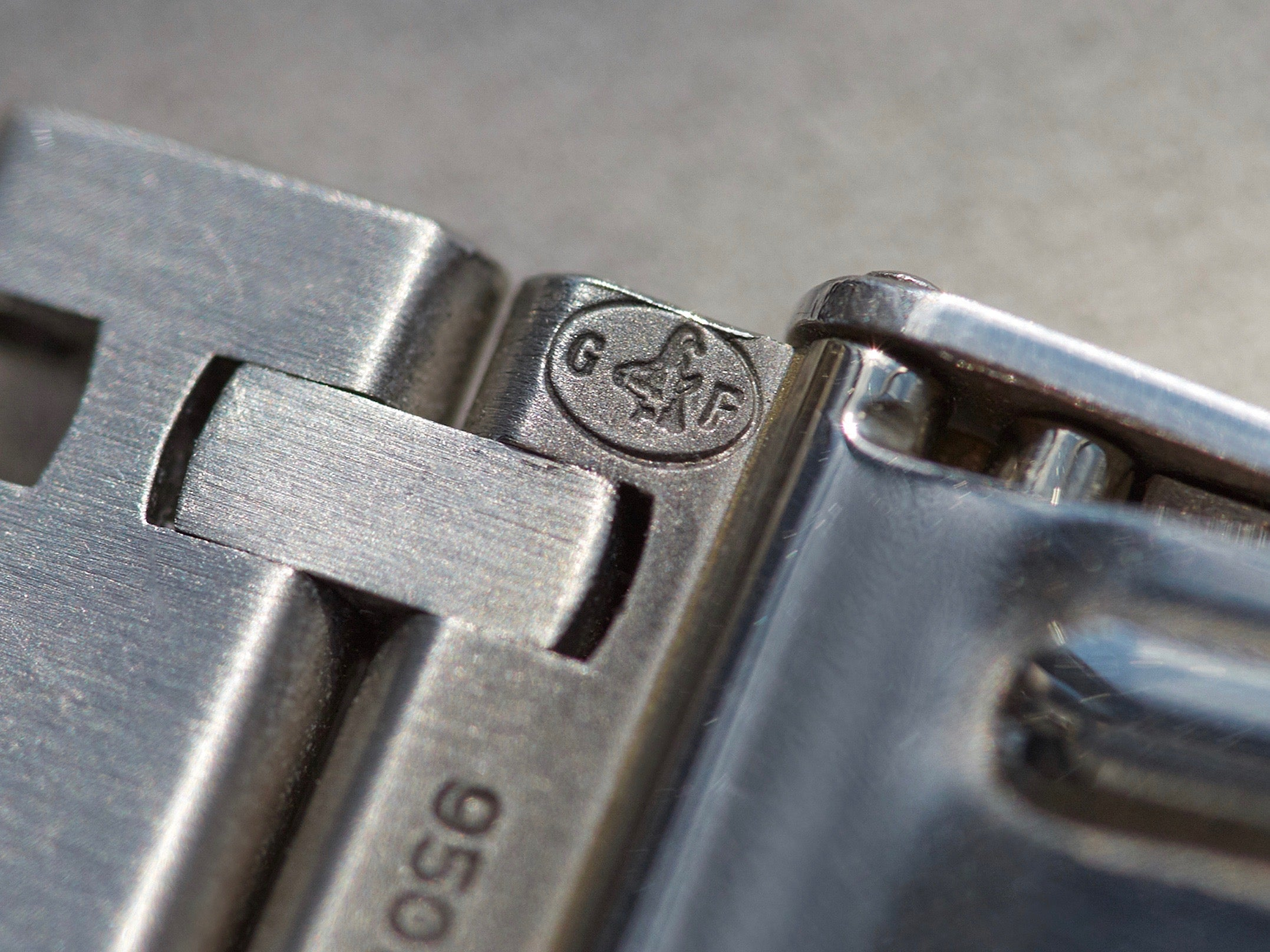 The stamped logo of Gay Freres inside a watch clasp for A Collected Man London
