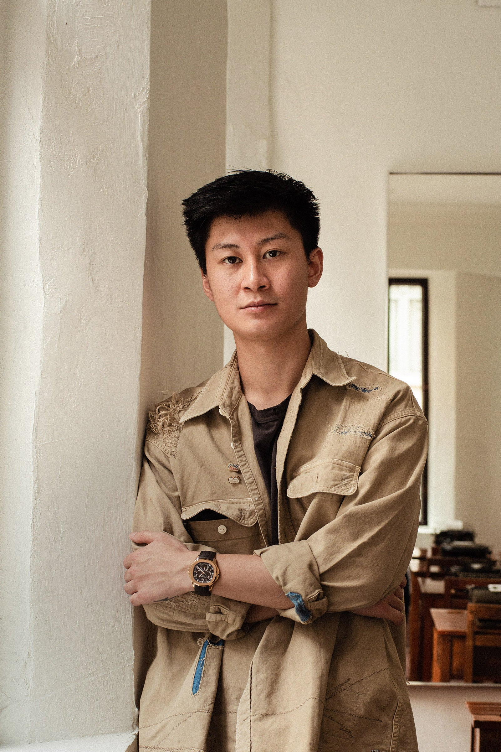 Arby Li vice president of strategy at HYPEBEAST in the Tai Hang region of Hong Kong wearing his Patek Philippe Aquarnaught travel time for A Collected Man London