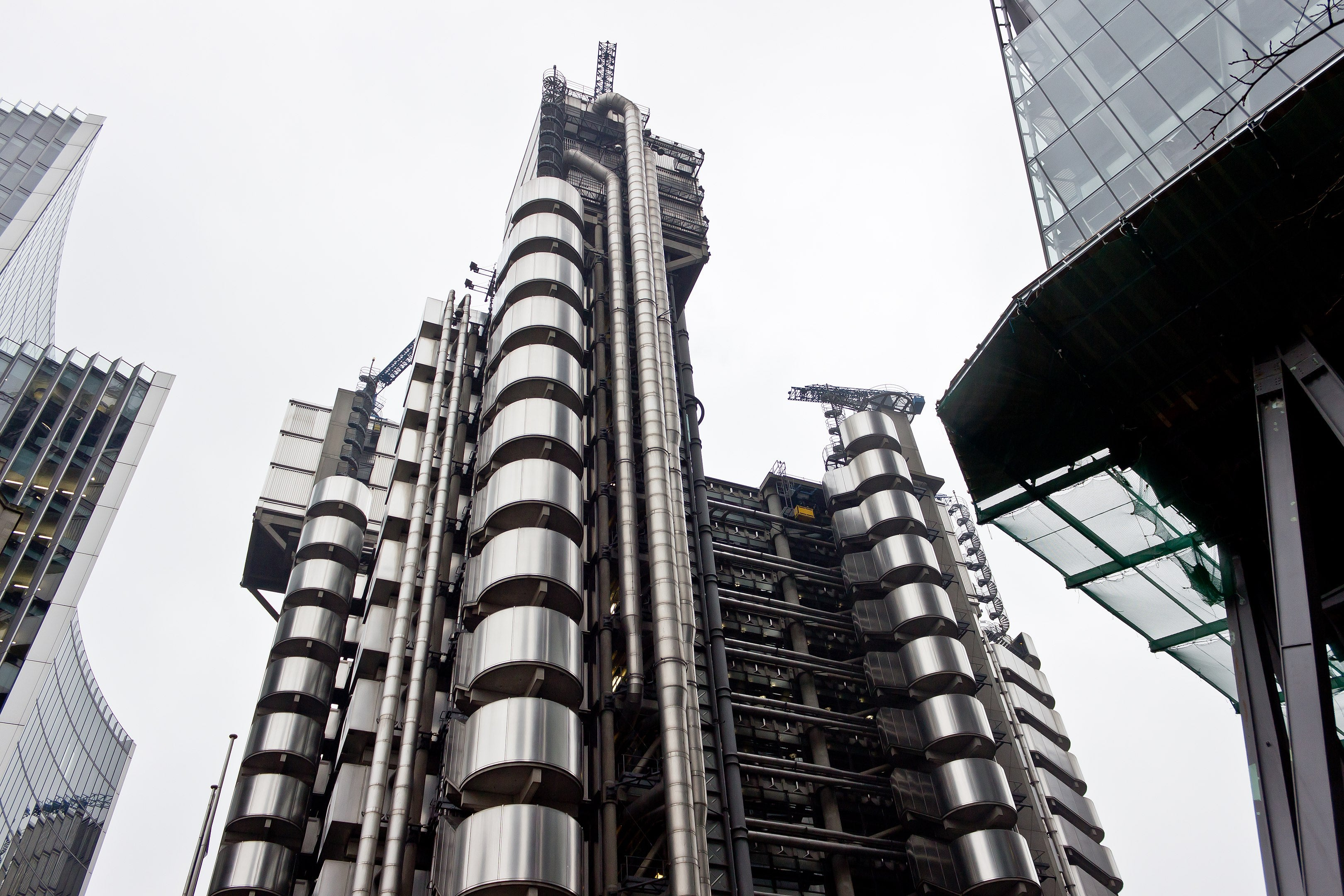 Lloyd's building in London designed by Richard Rogers exterior with exposed metal work and spirals for A Collected Man London