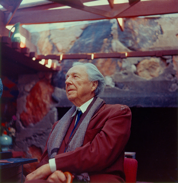 Frank Lloyd Wright posing for a bust in his home at Taliesin West