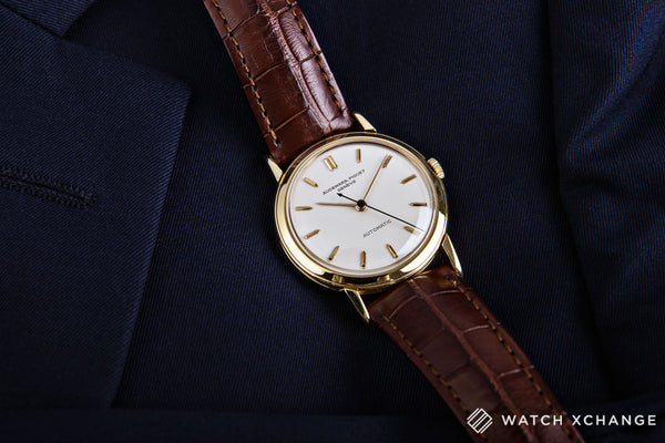 Audemars Piguet Vintage Automatic 18-carat yellow gold automatic Cal. K2071 vintage authentic pre-owned dress, rare luxury watch from circa 1960s with cream silver dial and brown alligator strap with hours, minutes, center seconds