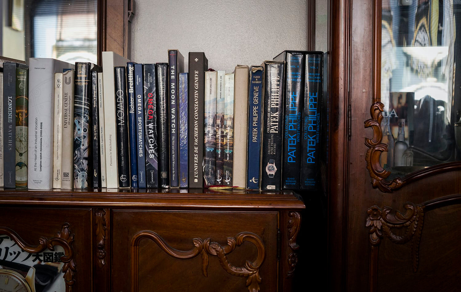 Book shelves of watch books from Private Eyes vintage watch shop in Tokyo for A Collected Man London