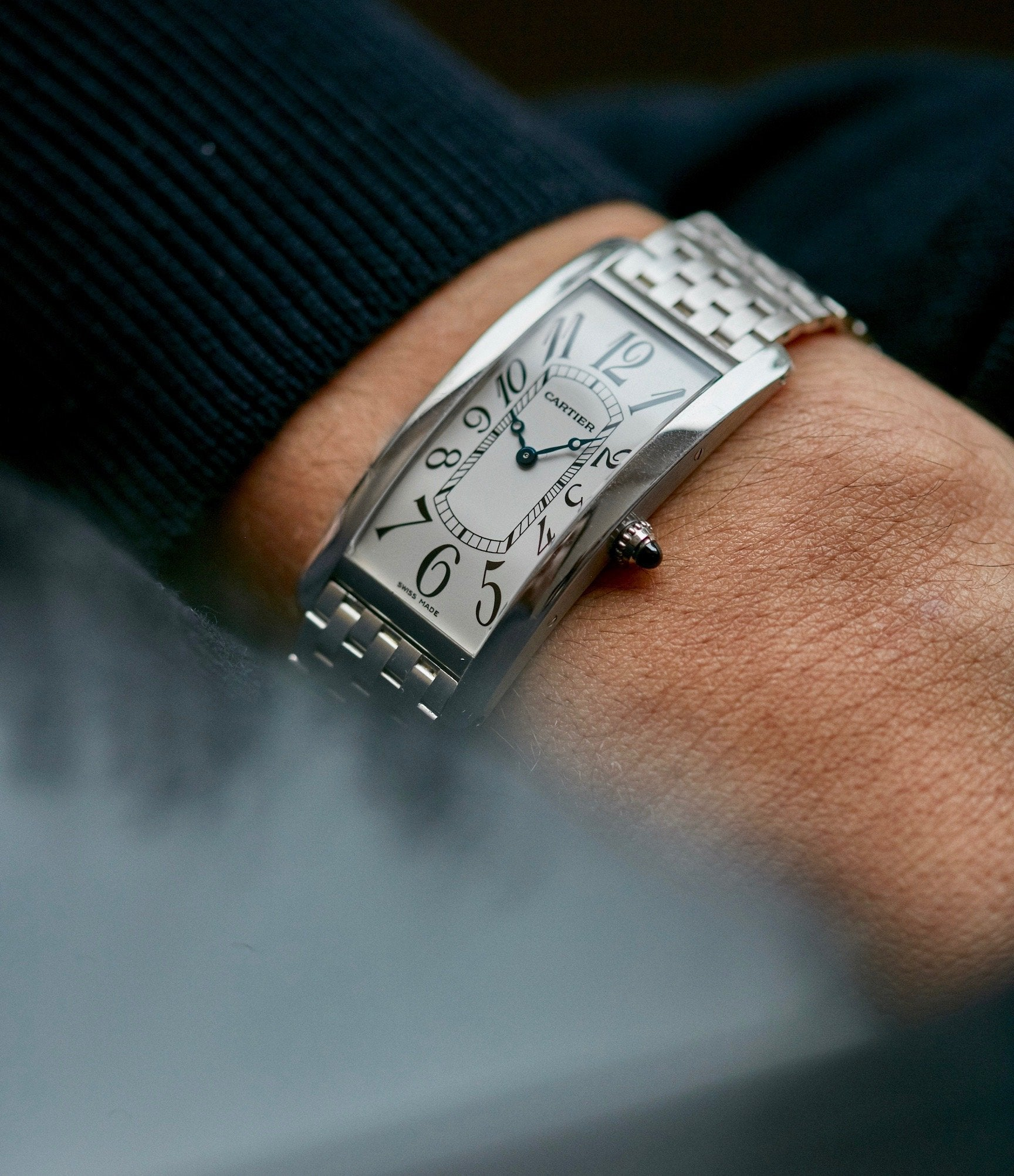 """Cartier Tank Cintrée Platinum watch on wrist In A Collector's Guide to the """"Collection Privée Cartier Paris"""" for A Collected Man London"""