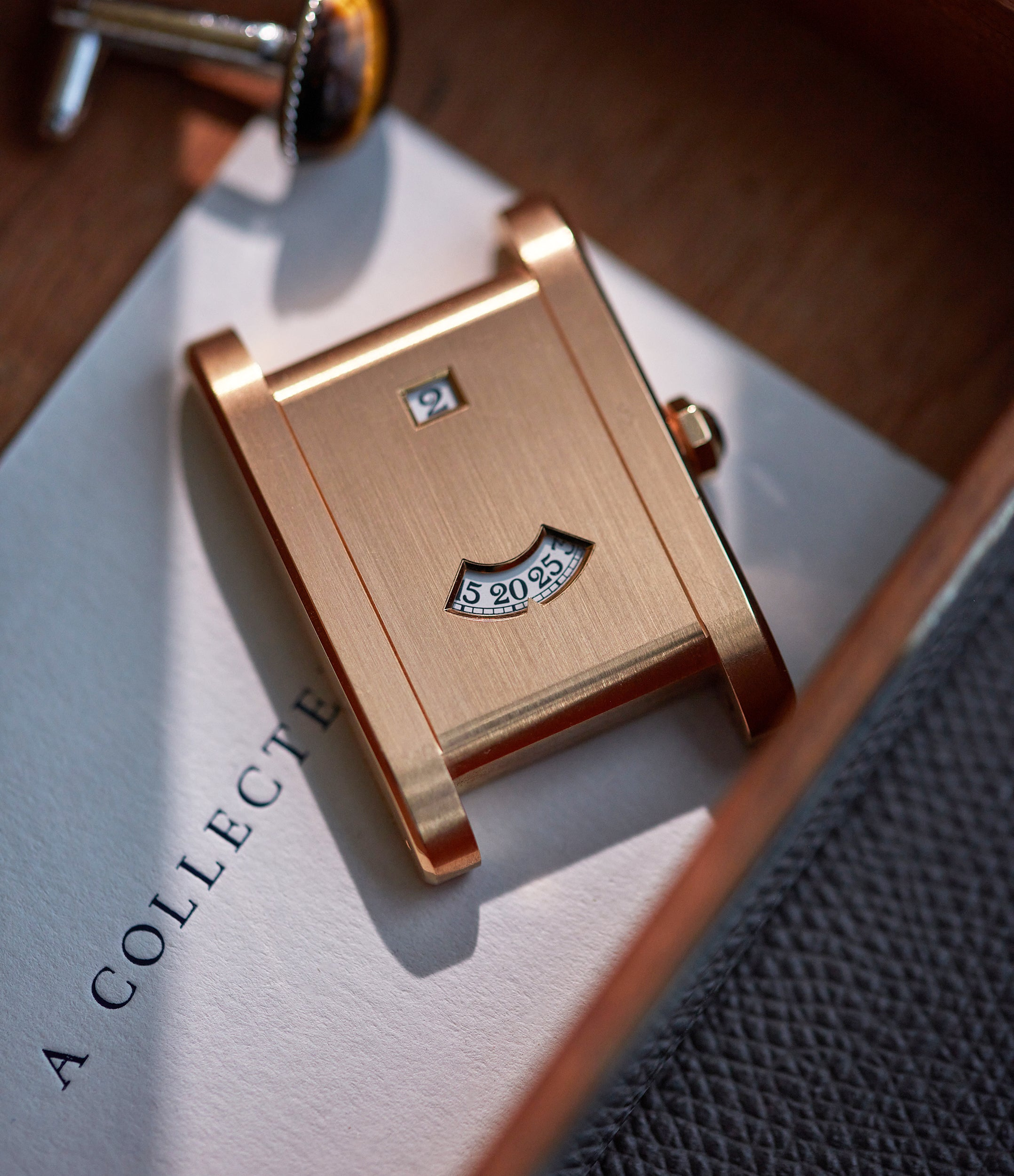 """Cartier CPCP Tank à Guichets watch in rose gold on table In A Collector's Guide to the """"Collection Privée Cartier Paris"""" for A Collected Man London"""