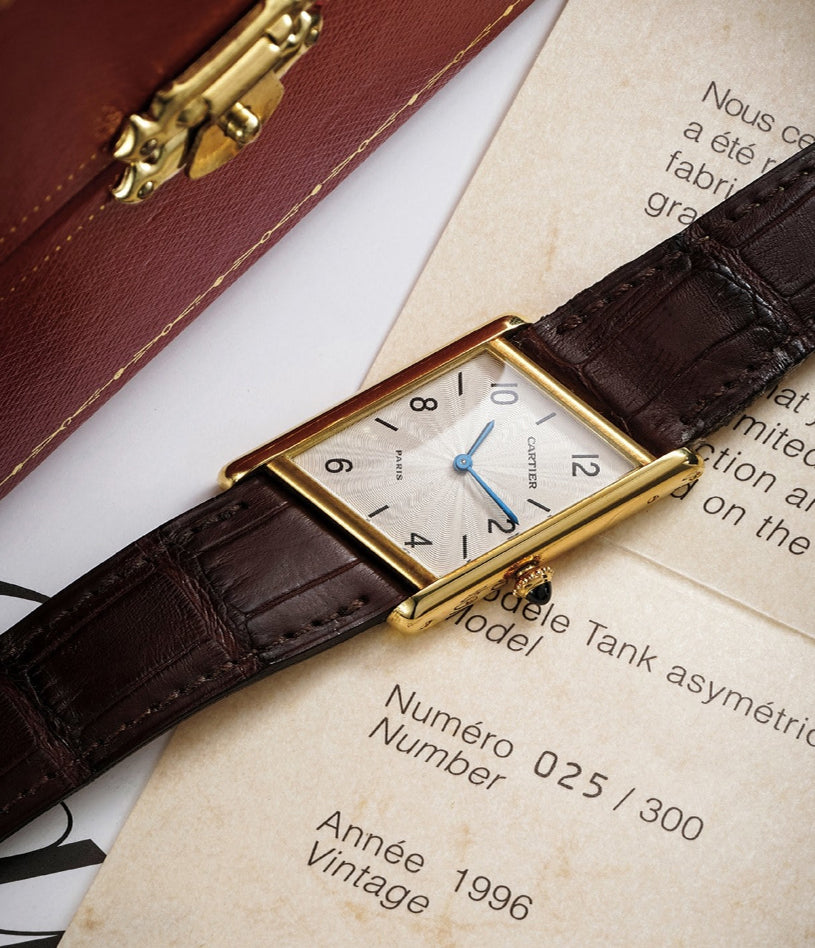 """Cartier CPCP Tank Asymétrique watch on paperwork In A Collector's Guide to the """"Collection Privée Cartier Paris"""" for A Collected Man London"""