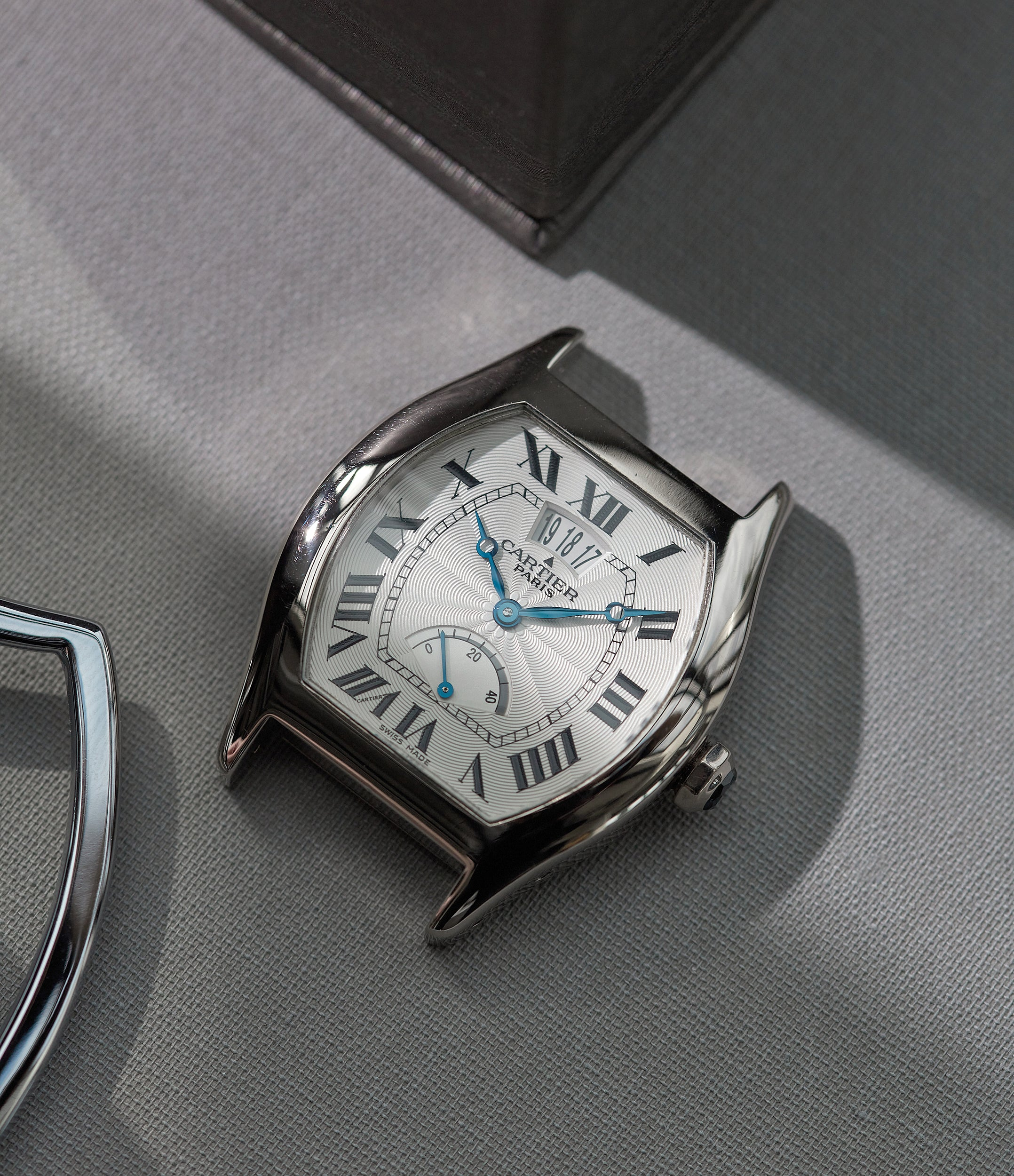 """Cartier CPCP white gold Tortue power reserve on table In A Collector's Guide to the """"Collection Privée Cartier Paris"""" for A Collected Man London"""