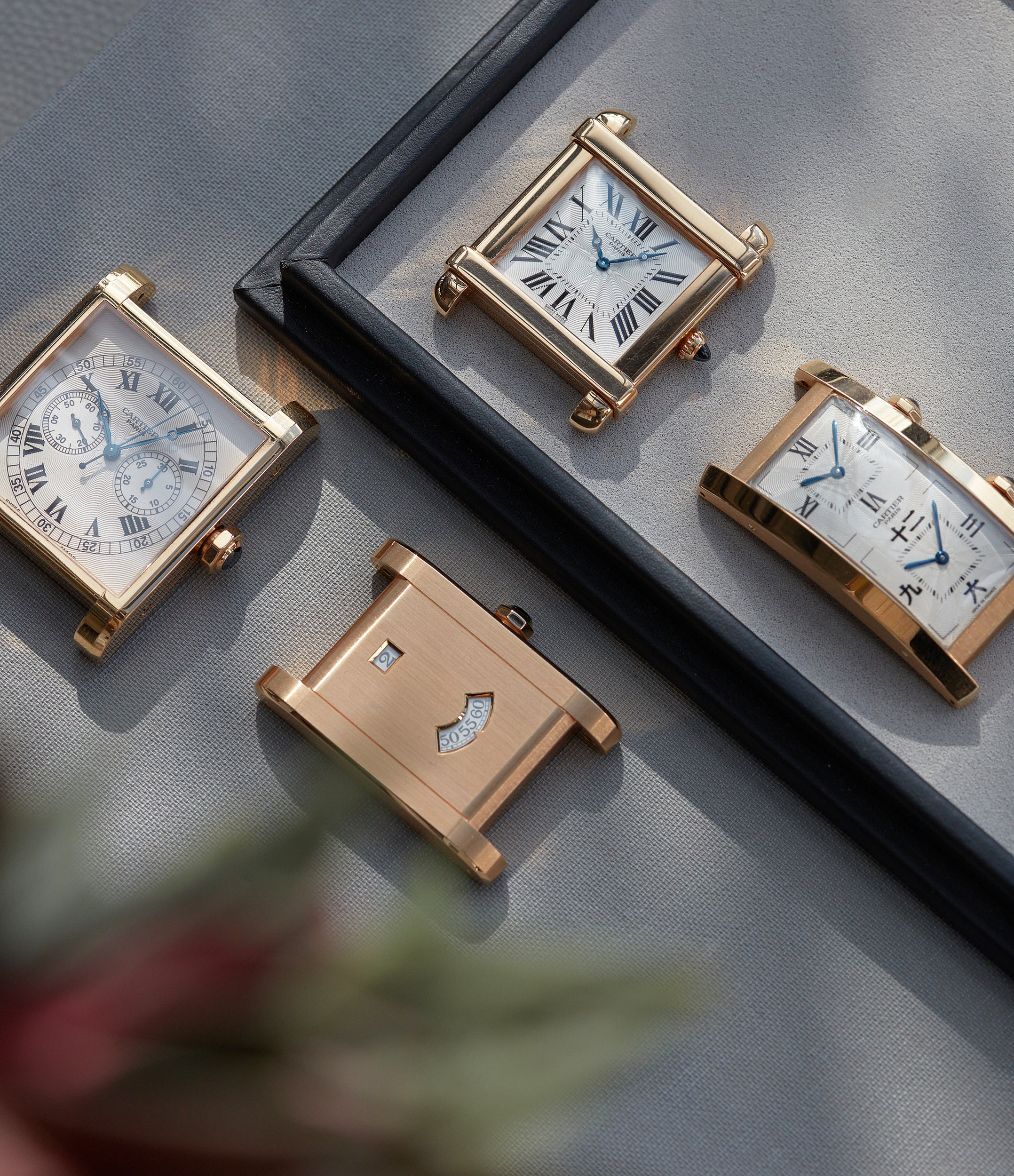Cartier CPCP watches on a table