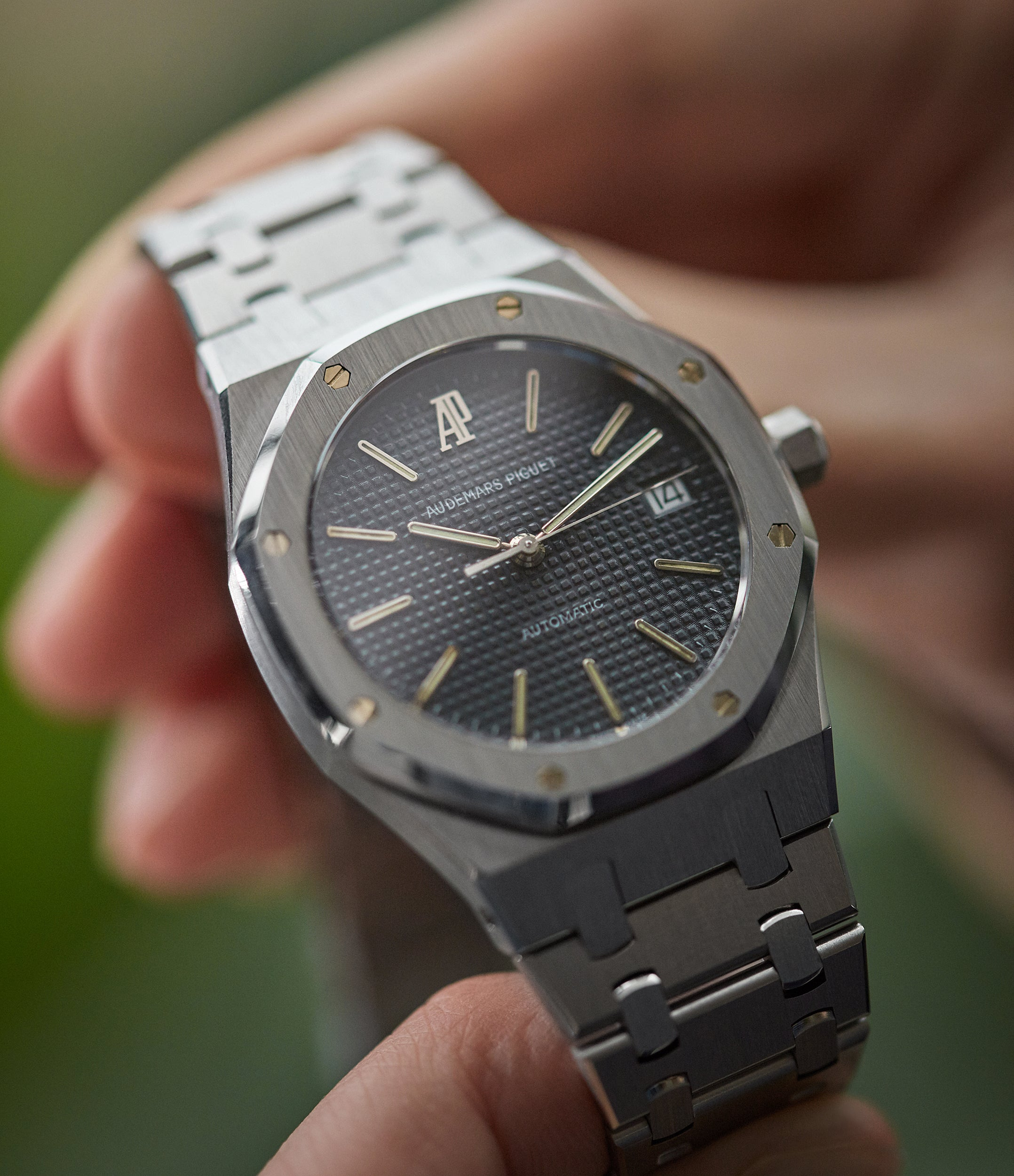 Audemars Piguet Royal Oak 14700 holding shot in stainless steel with black dial for A Collected Man London