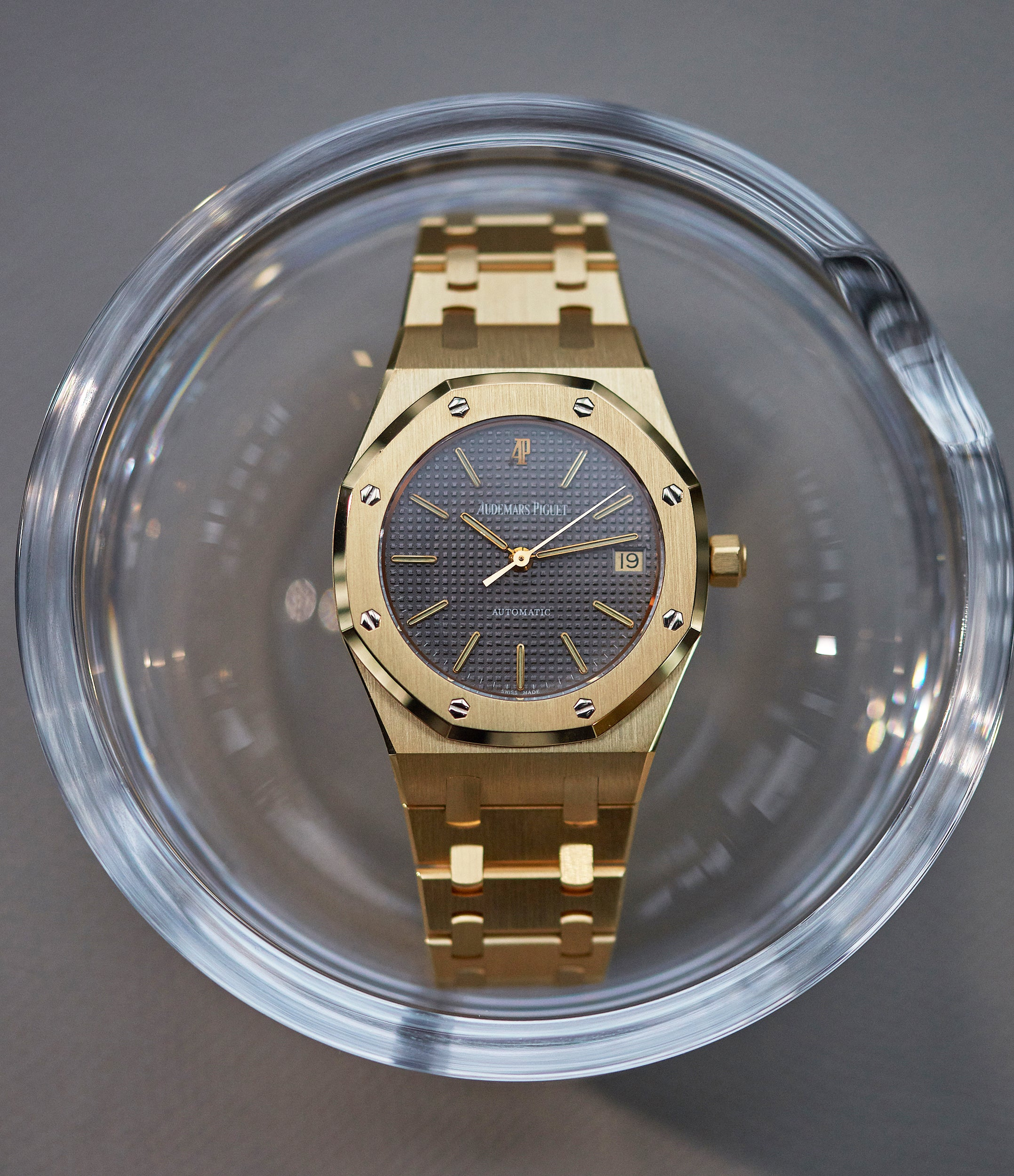 Audemars Piguet Royal Oak 14790 in yellow gold with a black dial second series in a glass bowl for A Collected Man London