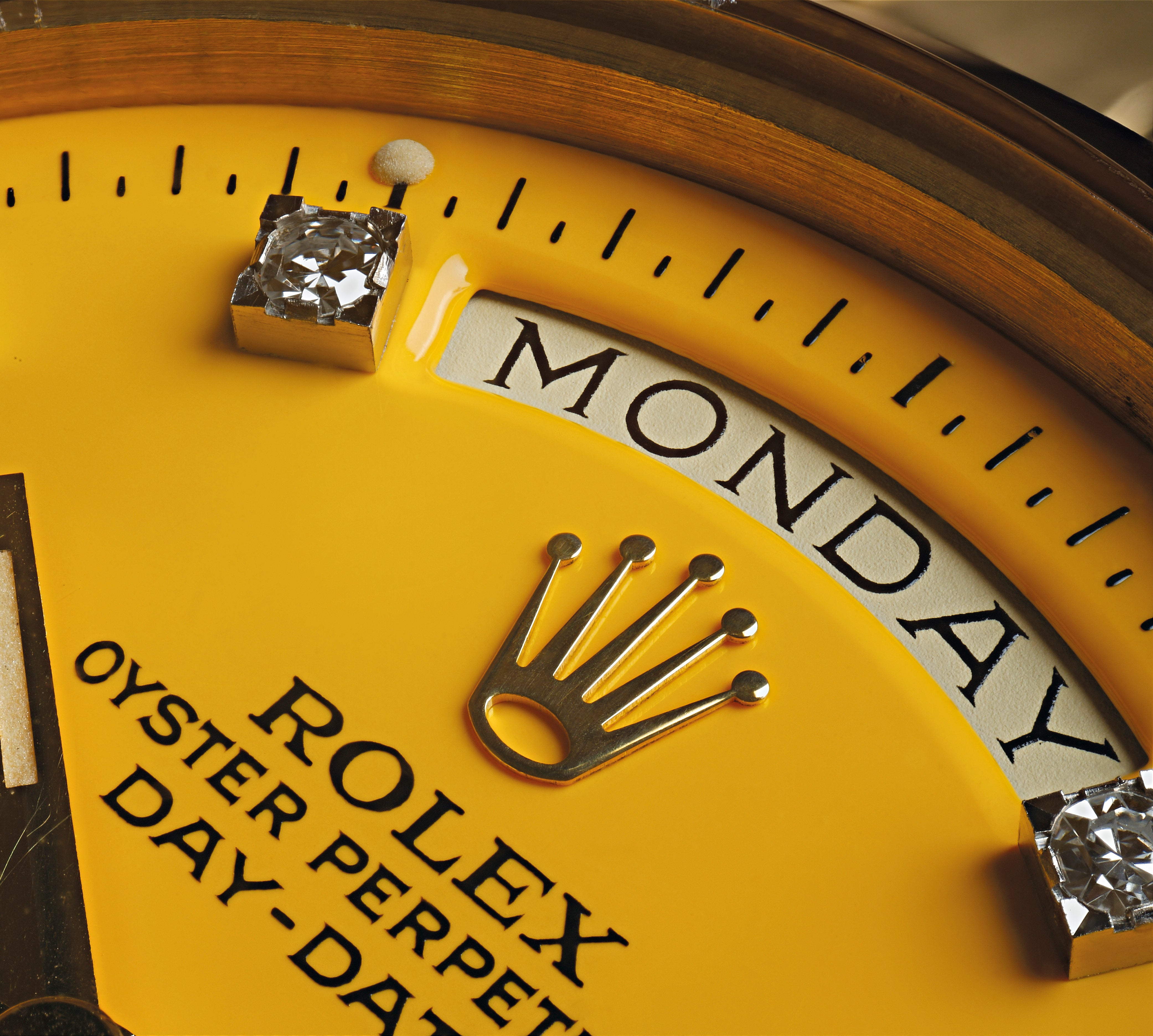 Macro shot of a Rolex Stella dial in yellow showing the layers of lacquer for A Collected Man London