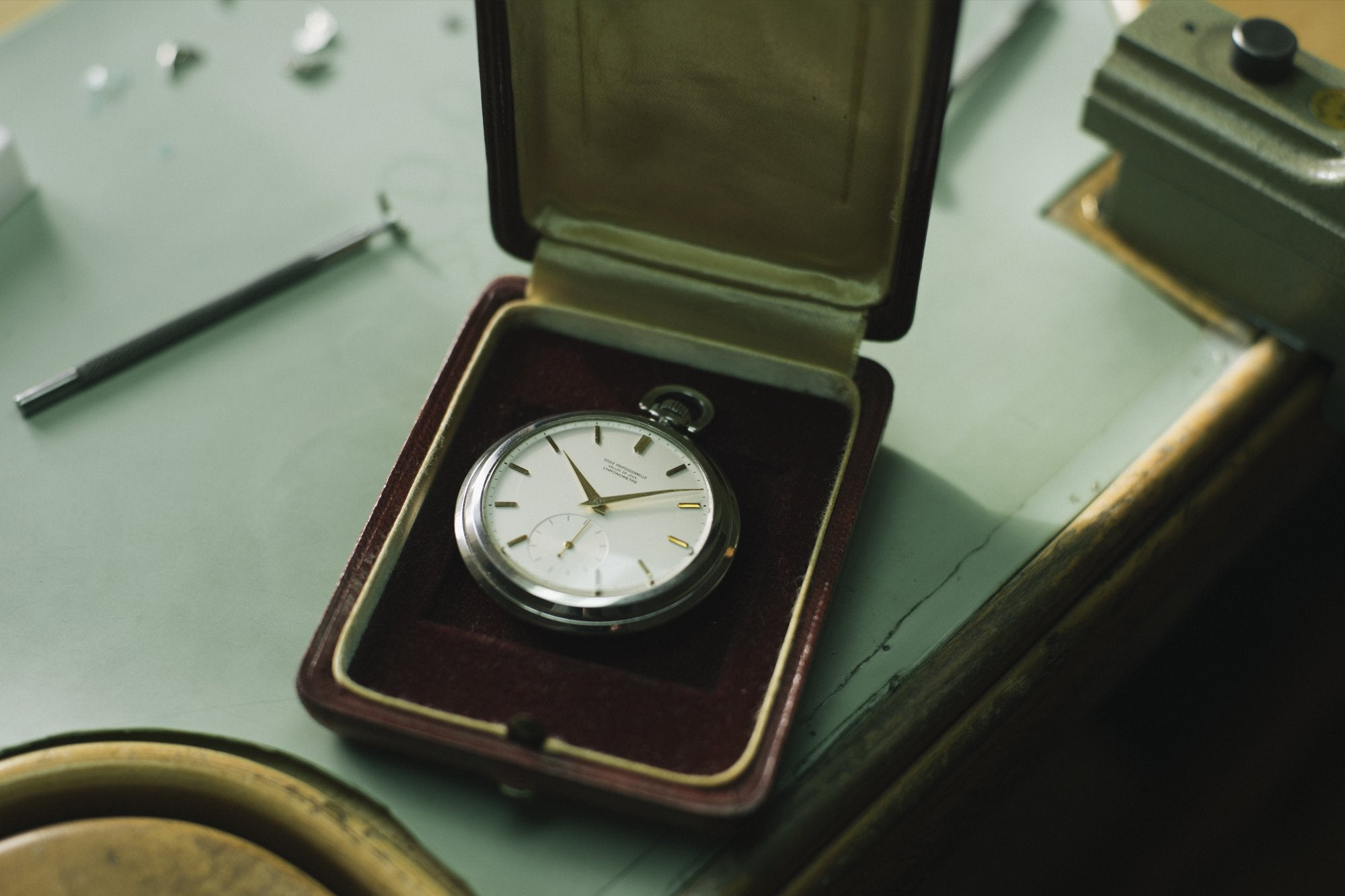 Philippe Dufour's school pocket watch in its case at his atilier in the Vallee de Joux from A Collected Man London