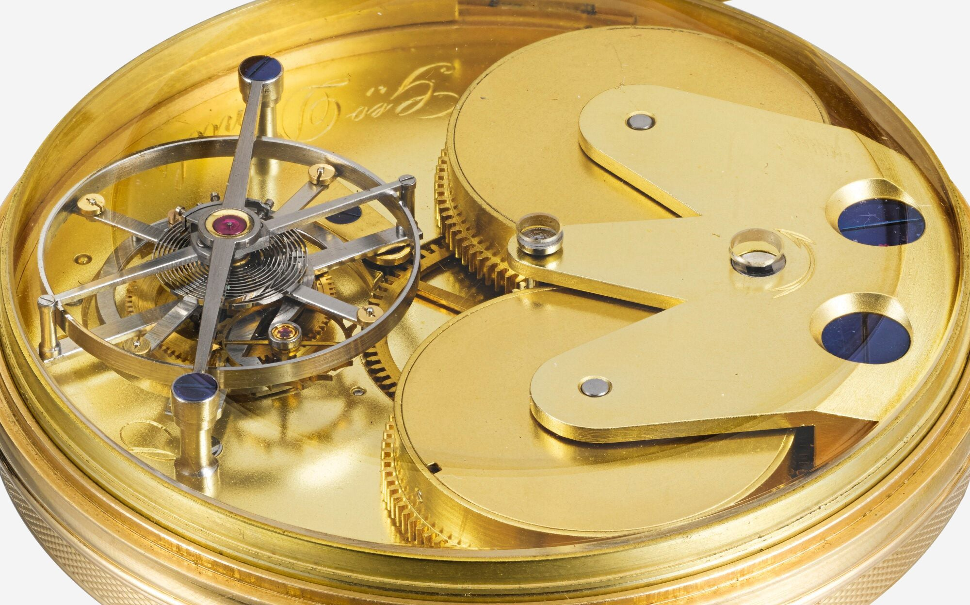 Macro shot of the movement of a tourbillon pocket watch made by George Daniels