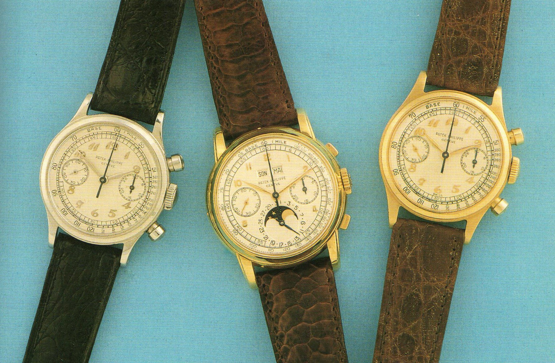 Three Patek Philippe chronographs on a blue background in The Early Days of Vintage Wristwatch Collecting for A Collected Man London