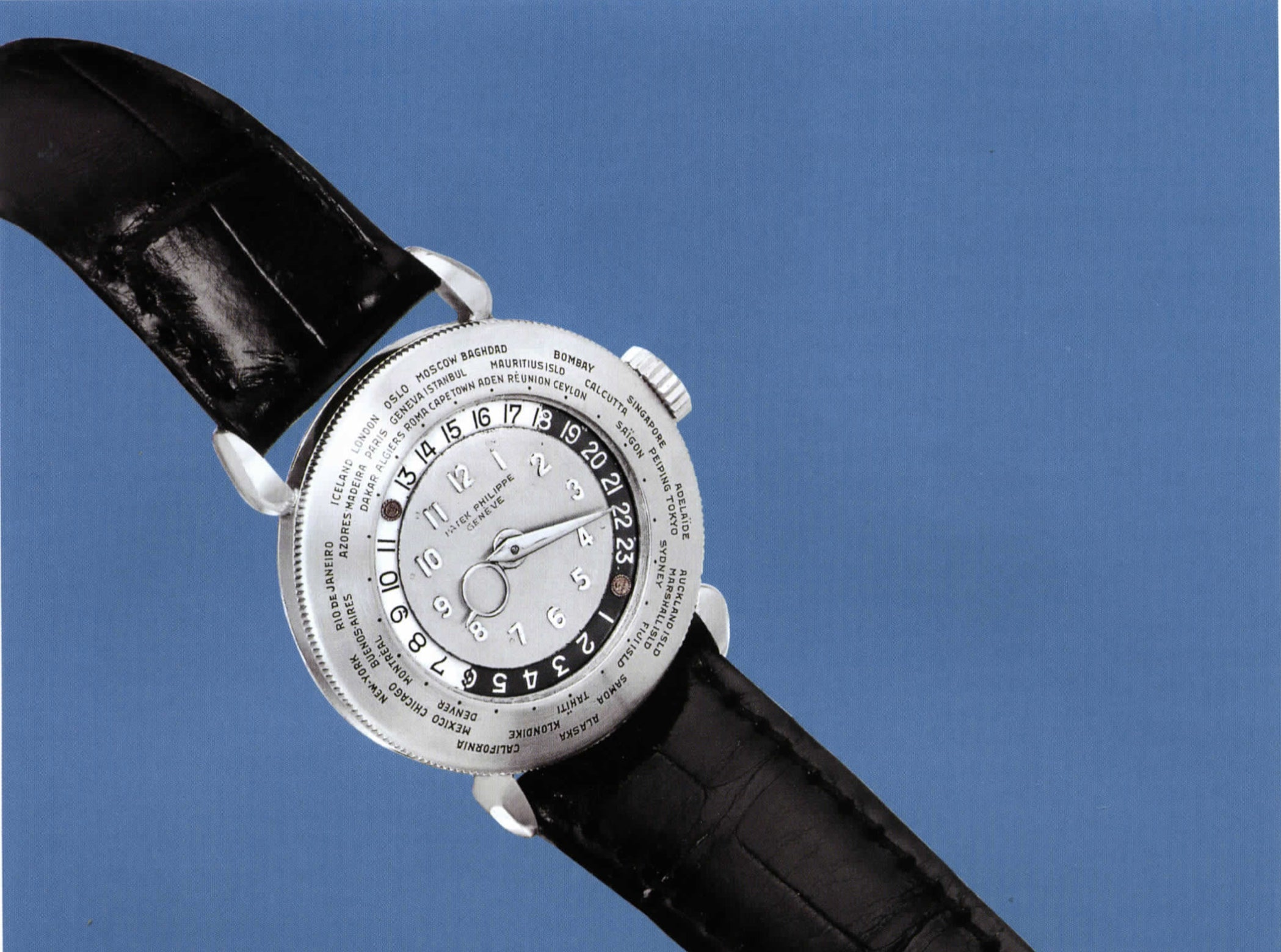 Patek Philippe 1415HU on blue background in The Early Days of Vintage Wristwatch Collecting for A Collected Man London
