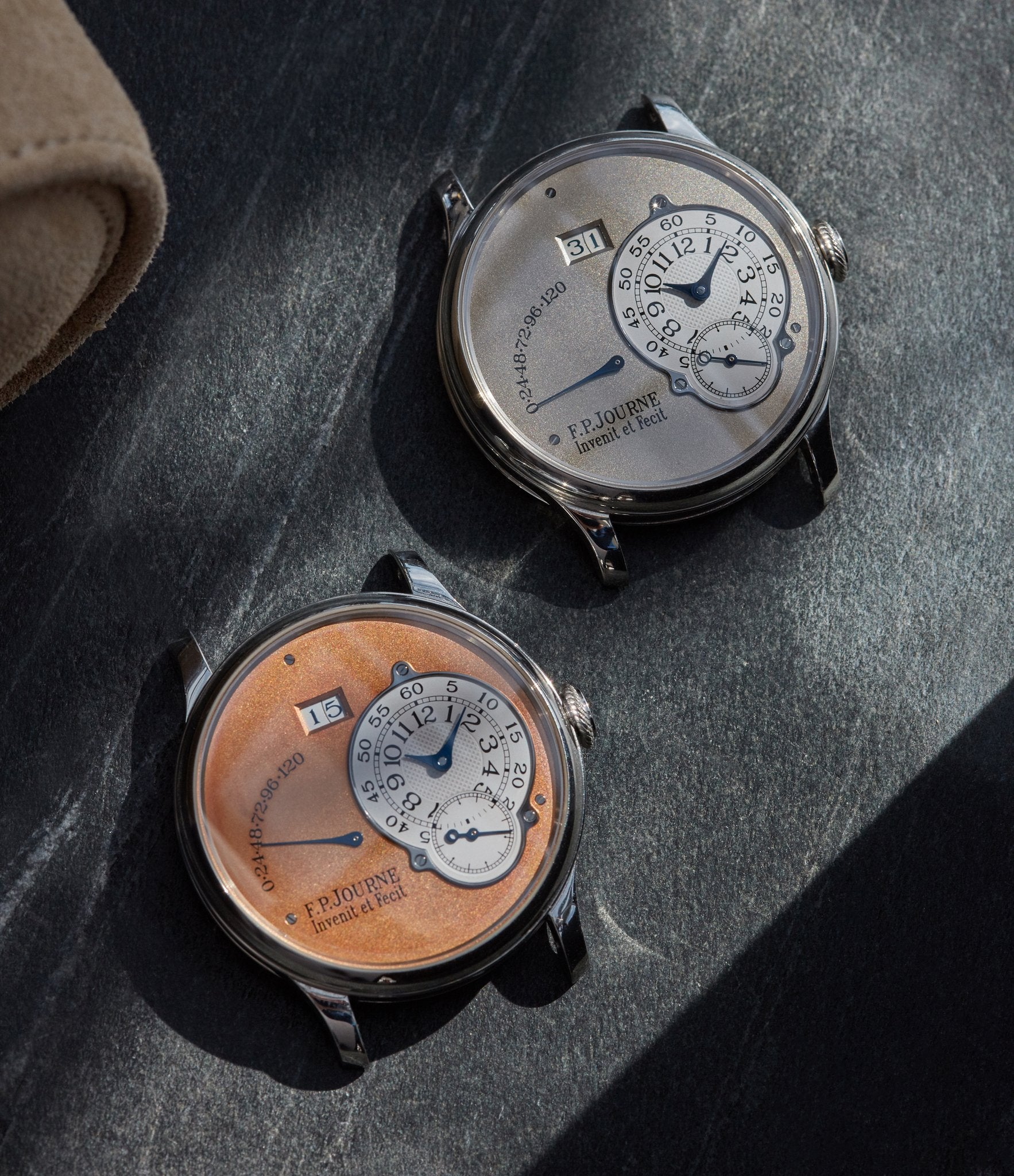 FP Journe Octa Reserve de Marche watches on table in Five Collectors Choose their Favourite Date Disc for A Collected Man London