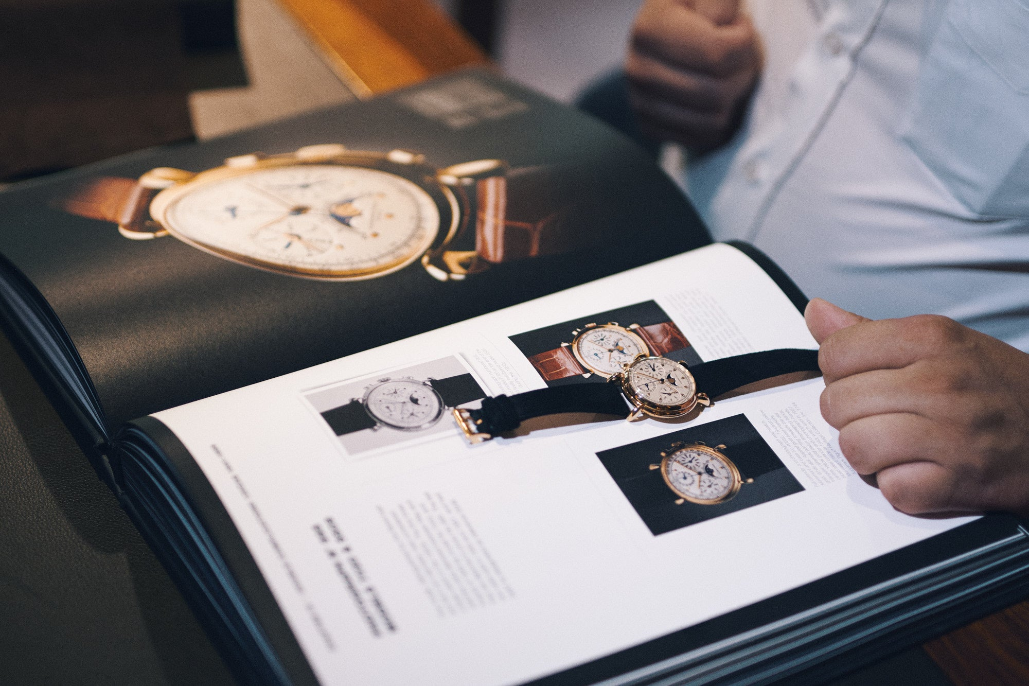 Inside the Audemars Piguet archives in Le Brassus looking through the book Audemars Piguet 20th Century Complicated Wristwatches for A Collected Man London