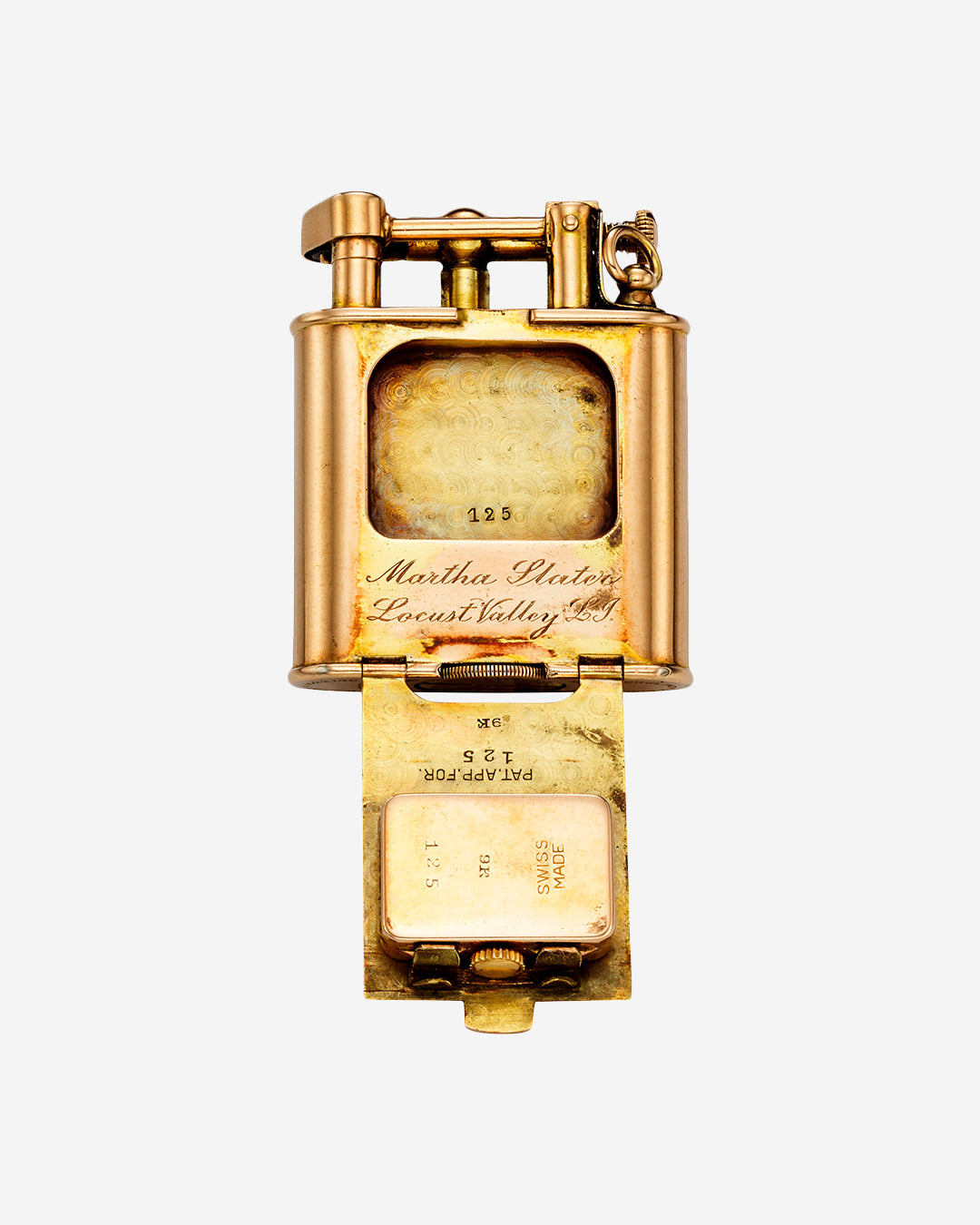 The Back Movement of a Rose Gold Dunhill Lighter Watch in Our Favourite Horological Objects for A Collected Man London