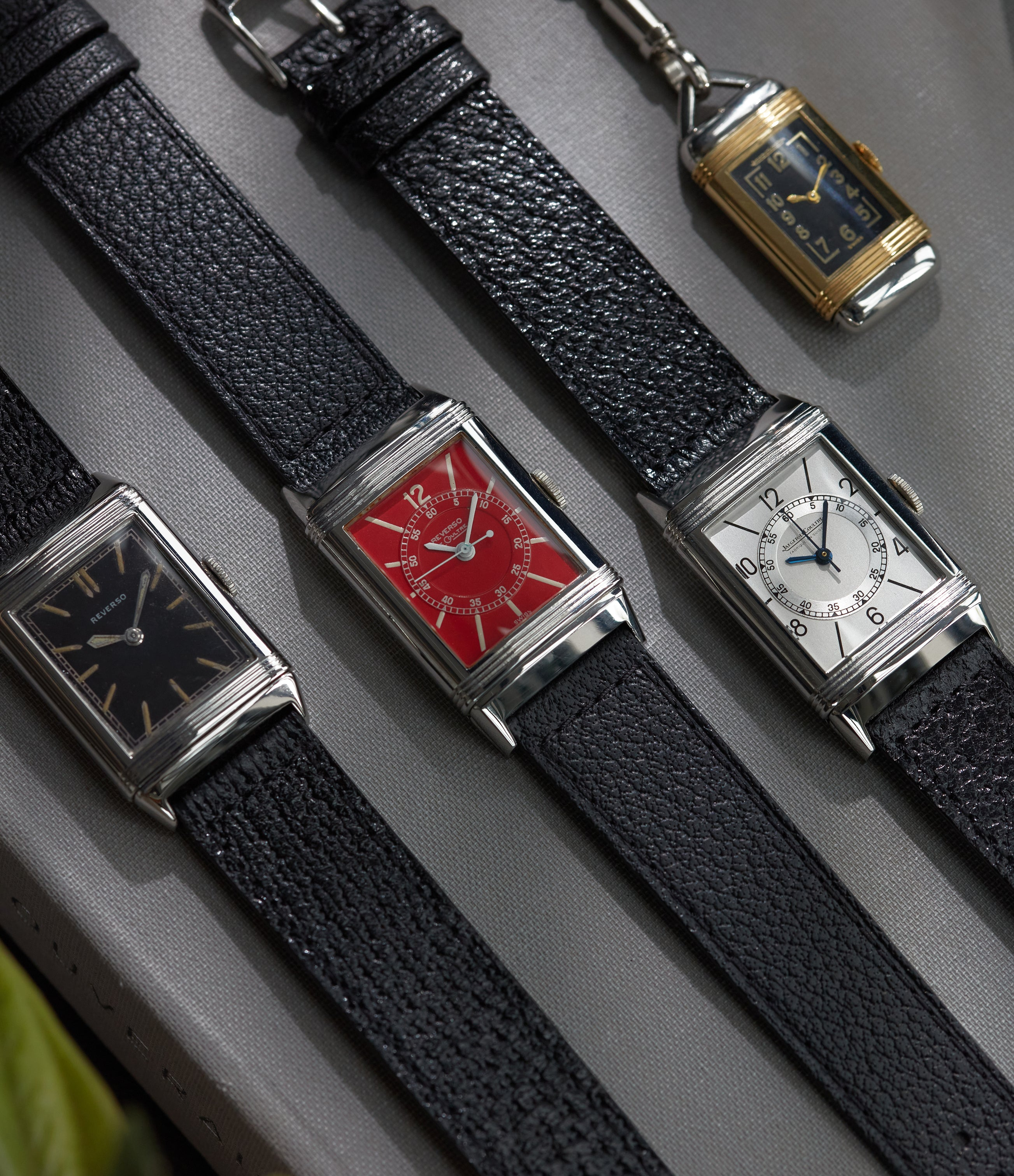 4 vintage Jaeger-LeCoultre Reversos laid down in The Flippin' History of the Reverso for A Collected Man