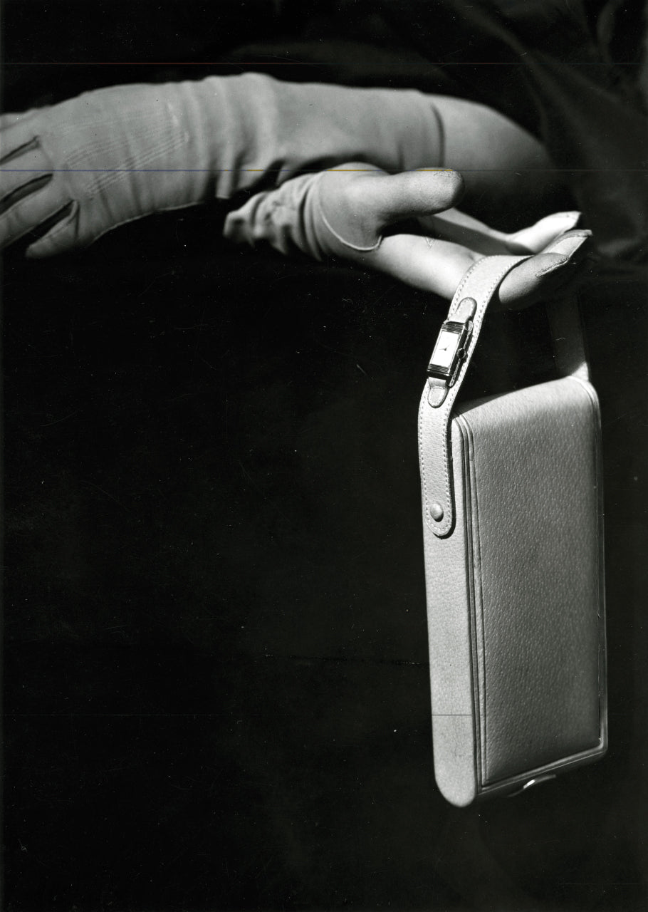 Advert with Jaeger-LeCoultre Reverso on handbag strap in The Flippin' History of the Reverso for A Collected Man