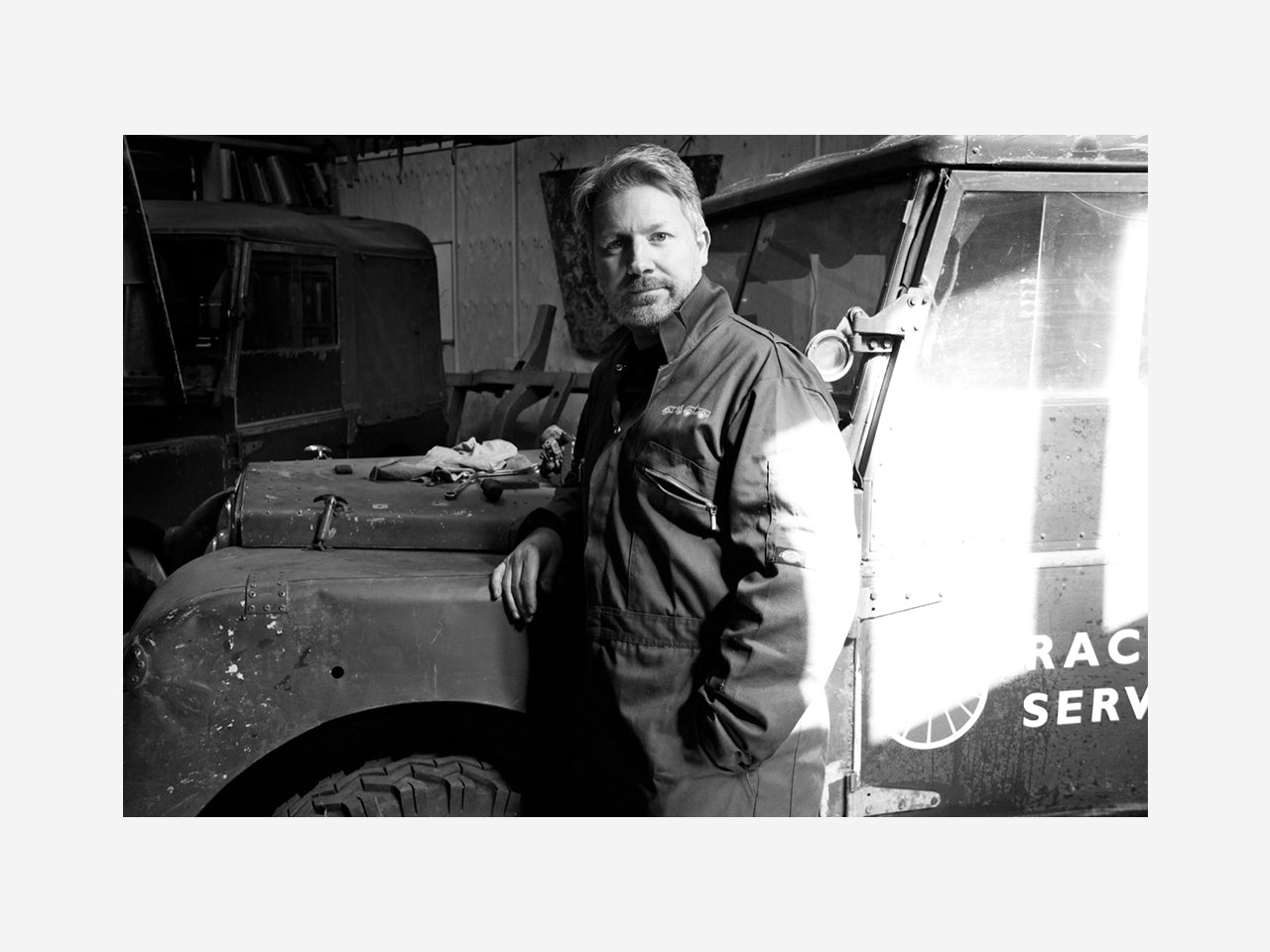 Julian Shoolheifer in his workshop with a Land Rover he has been restoring