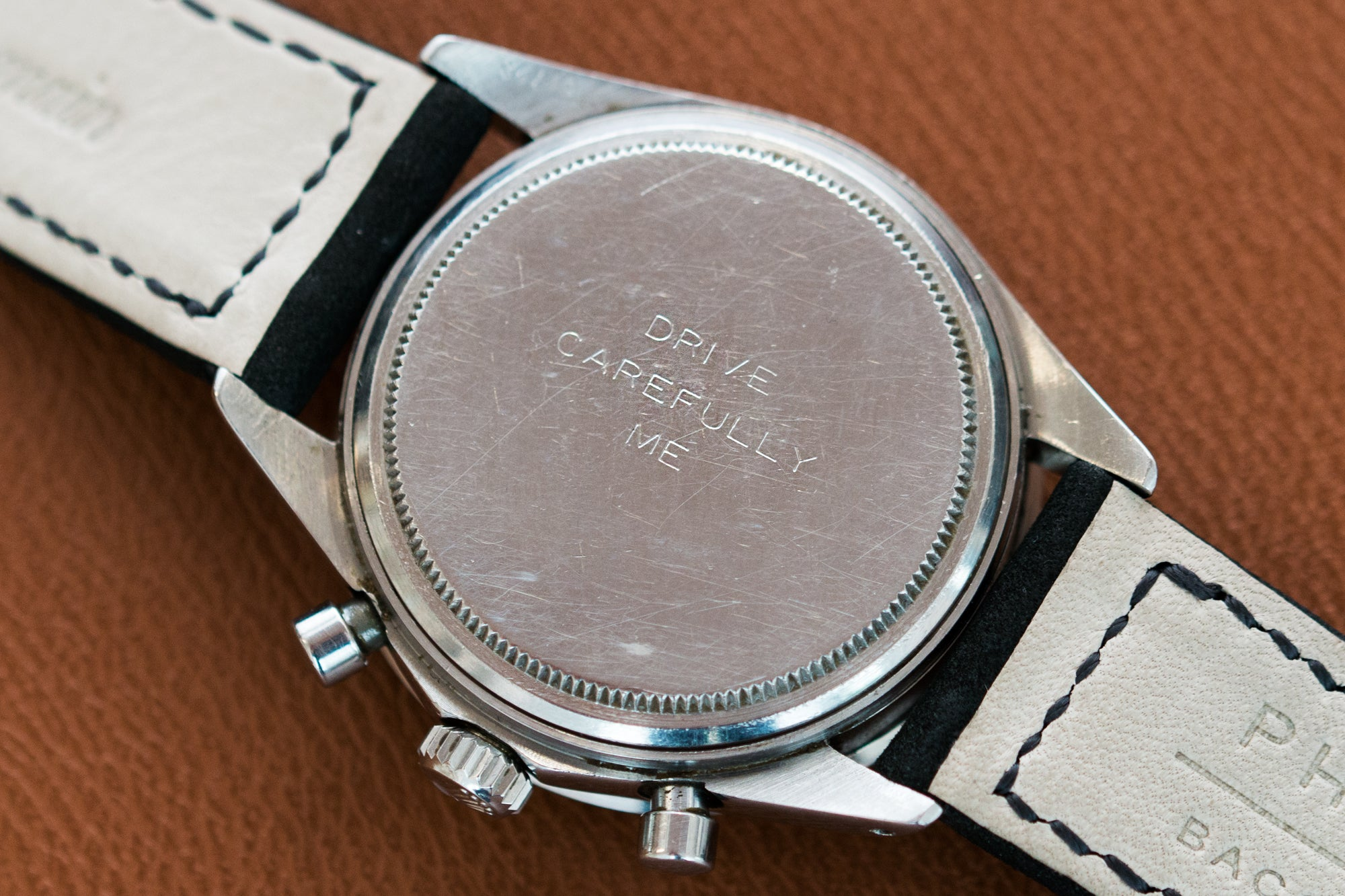 Paul Newman's personal Daytona with the caseback engraving 'DRIVE CAREFULLY ME' at A Collected Man London
