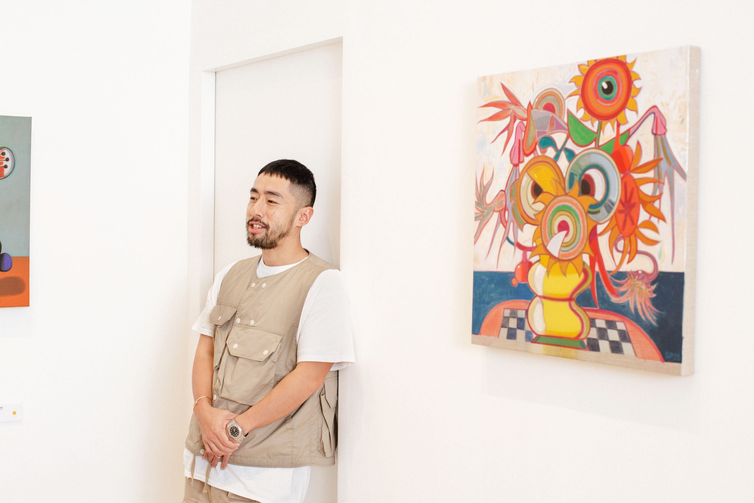 Poon stood by doorway in Obsessions: Contemporary Culture with Kevin Poon for A Collected Man London