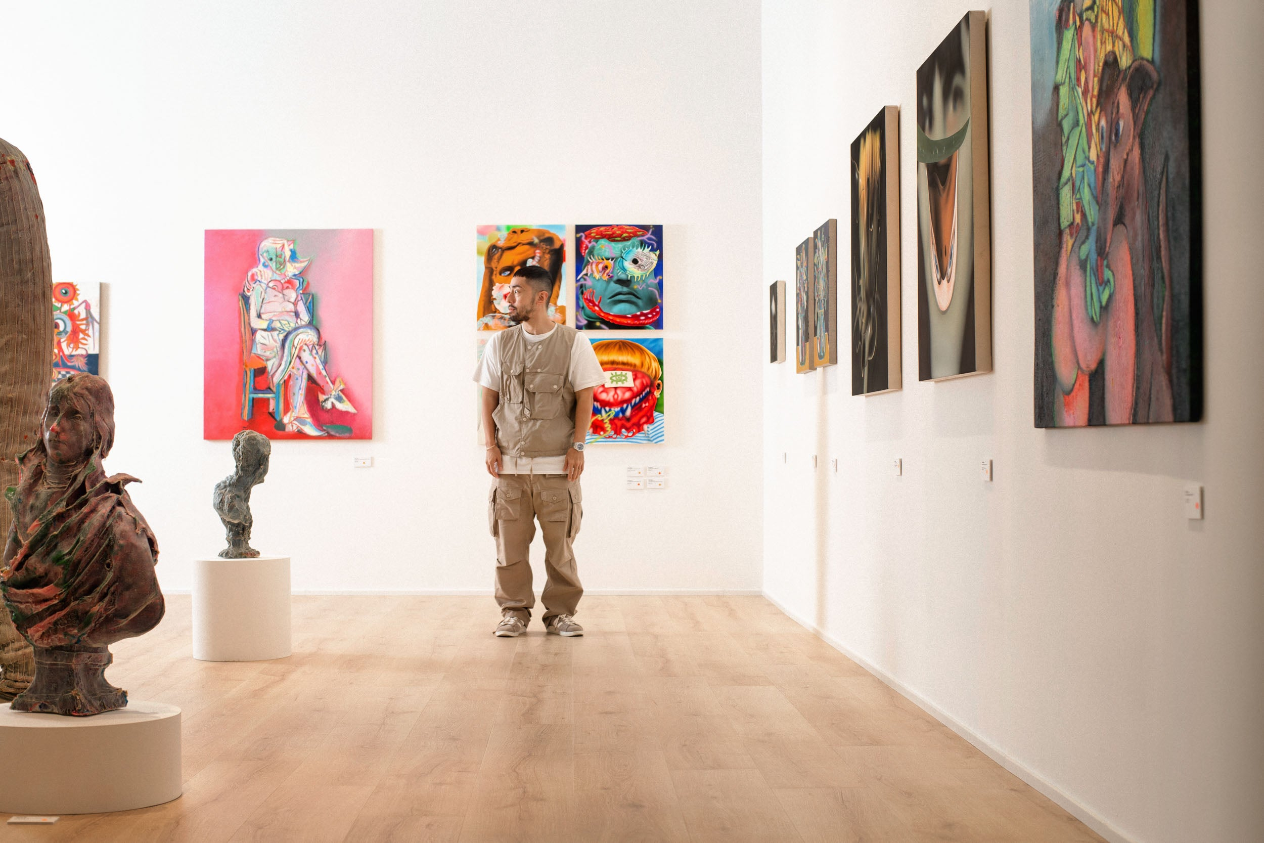 Poon stood in gallery at a distance in Obsessions: Contemporary Culture with Kevin Poon for A Collected Man London
