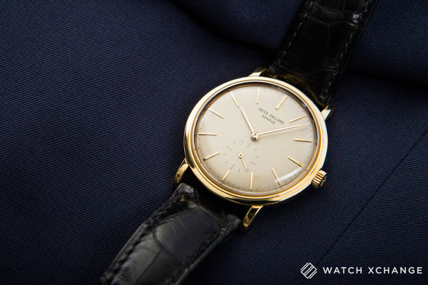 Patek Philippe Calatrava 3429 18-carat yellow gold automatic Cal. 27-460 vintage authentic pre-owned dress luxury watch from 1963 with silver dial and black crocodile strap with hours, minutes, small seconds