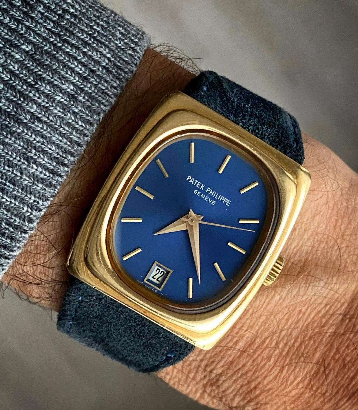 A Gold Patek Philippe watch ref 3603 with blue dial on wrist Why Patek Philippe has Always Cared About Quartz for A Collected Man London