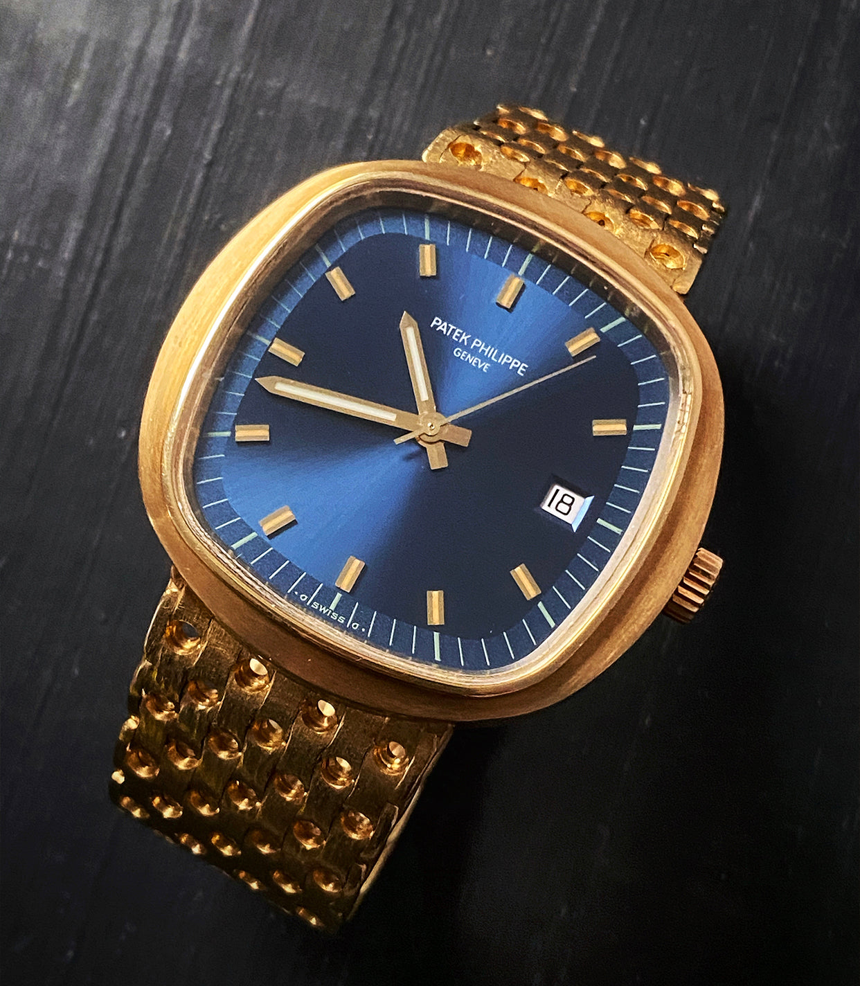 A Gold Patek Philippe watch ref 3587 with blue dial on table Why Patek Philippe has Always Cared About Quartz for A Collected Man London