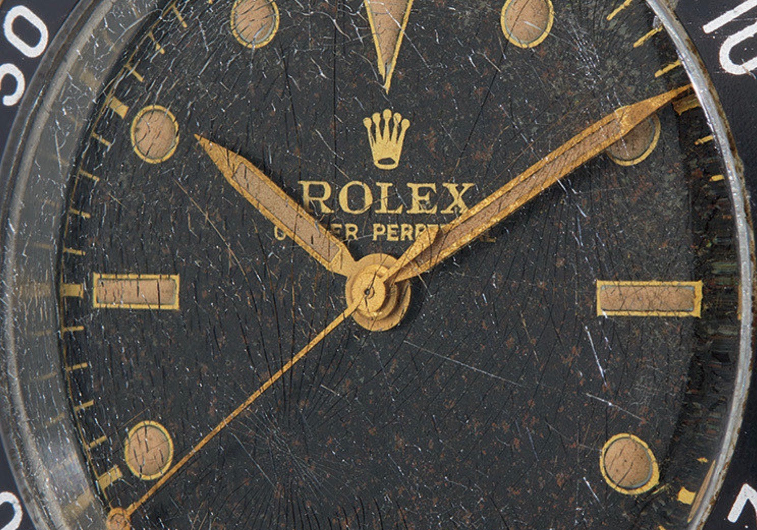 1954 Rolex Submariner with a cracked crystal and creamy lume plots sold at Phillips Game Changers auction