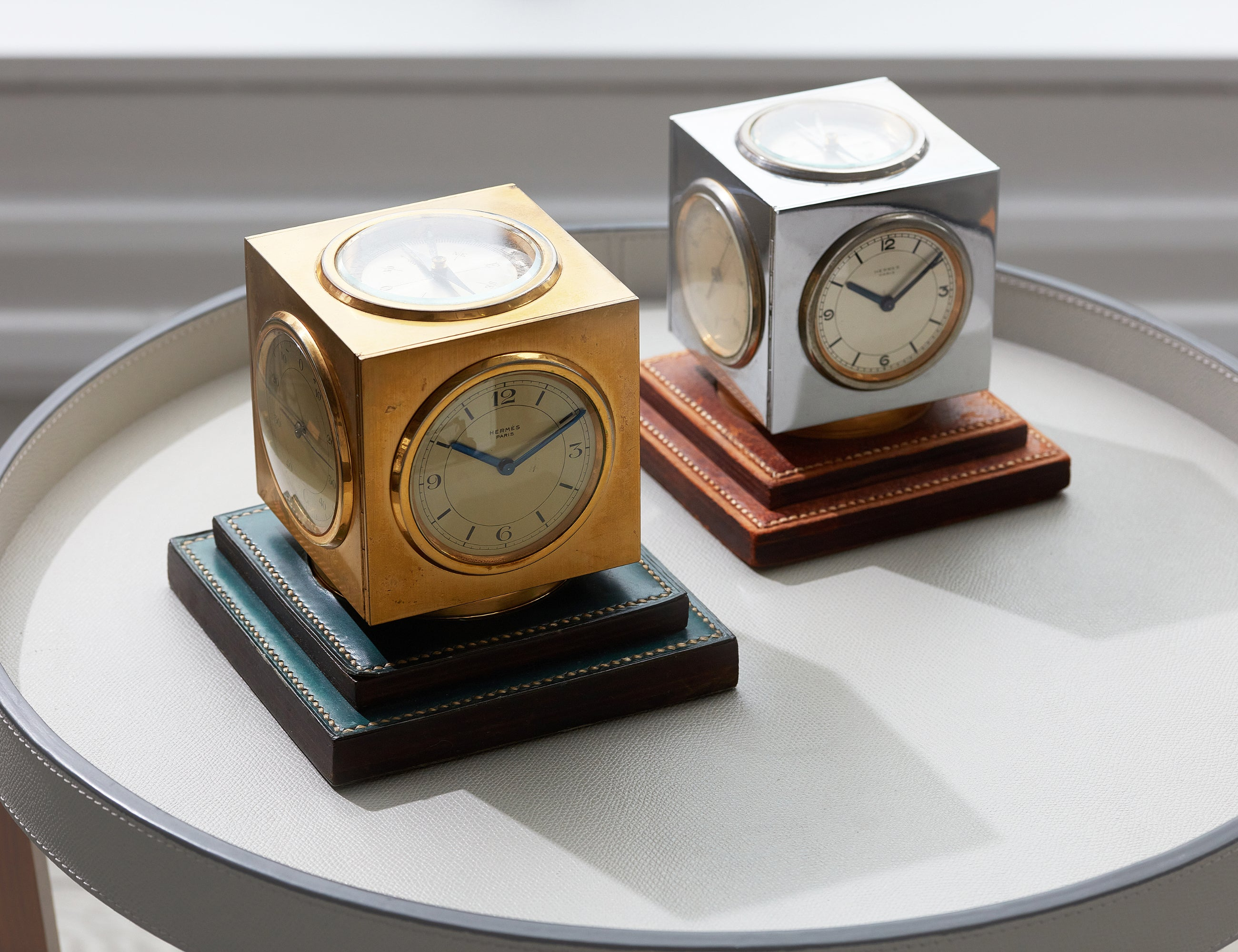 Two Hermès Compendium desk clocks in yellow gold and steel in How Paul Dupré-Lafon Became 'The Decorator of Millionaires' for A Collected Man London