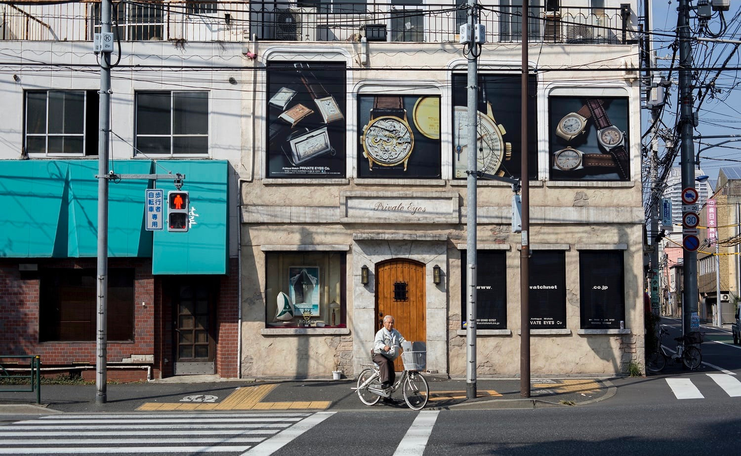 Front entrance of Private Eyes vintage watch shop in Tokyo residential district for A Collected Man London