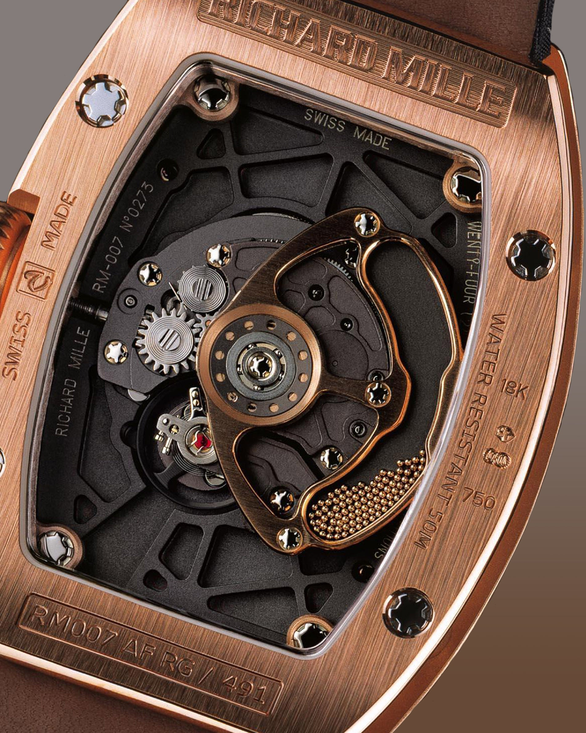 Richard Mille RM007 case back in rose gold showing micro balls inside the rotor for A Collected Man Lonodn