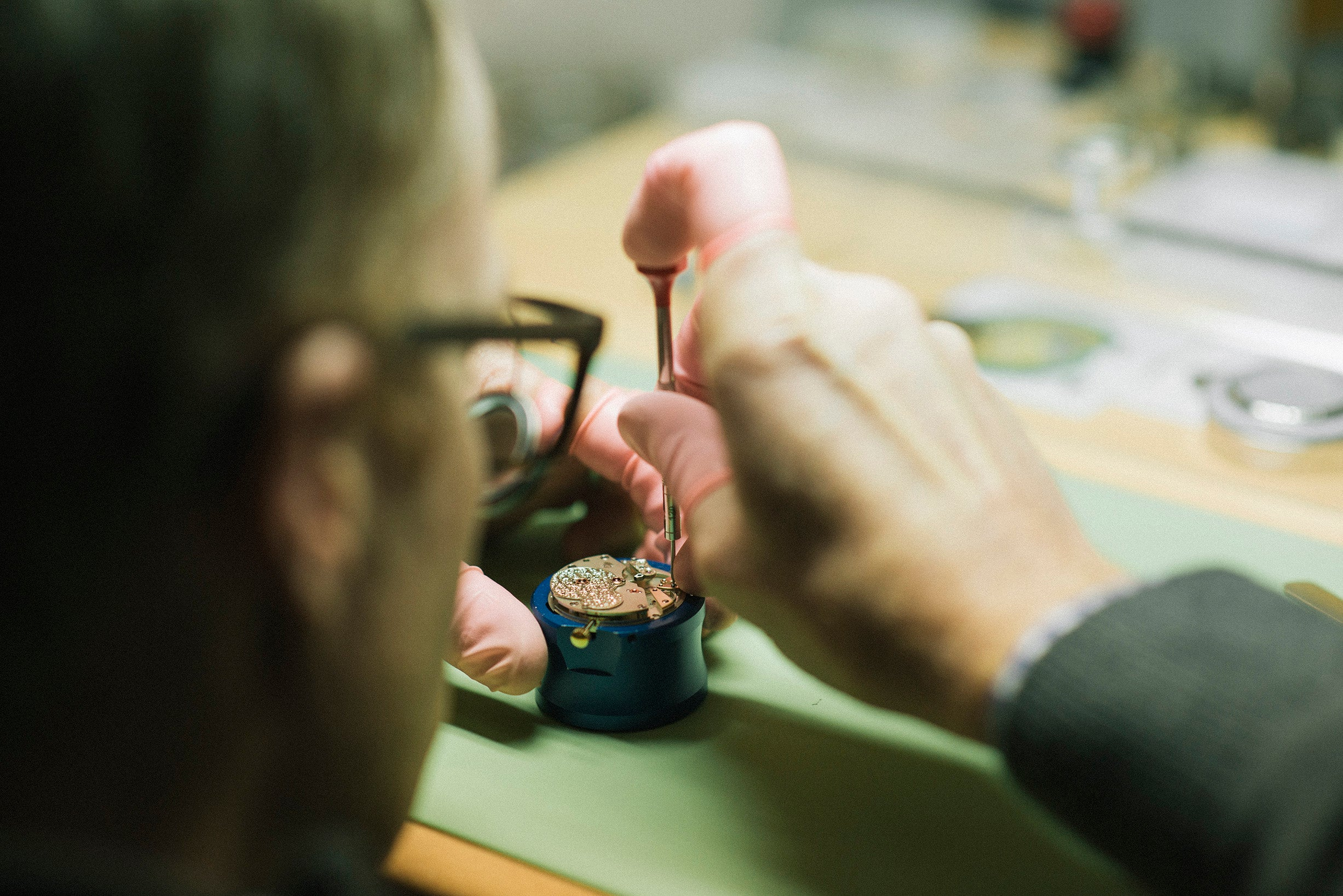 Roger W. Smith watchmaker at the bench building a wristwatch movement for A Collected Man London