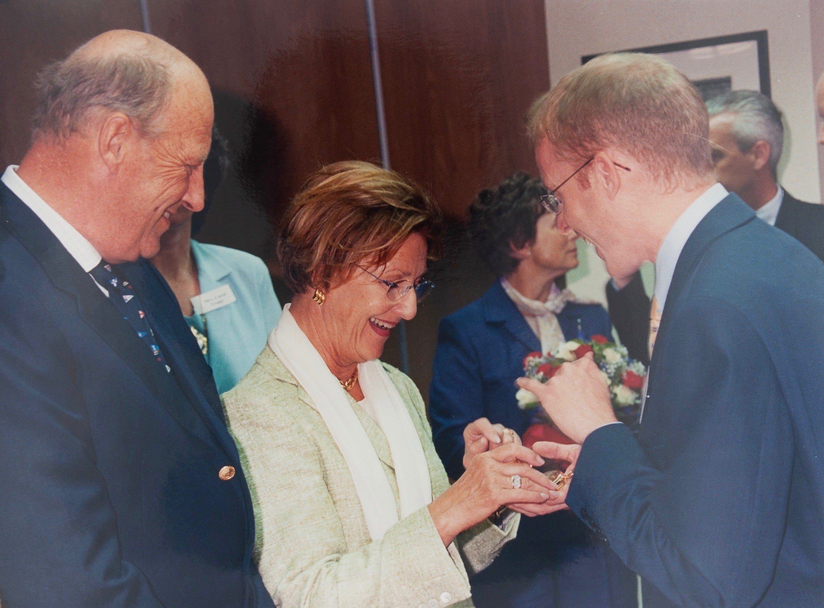 Roger W. Smith watchmaker showing the King and Queen of Norway a watch on their visit to the Isle of Man for A Collected Man London